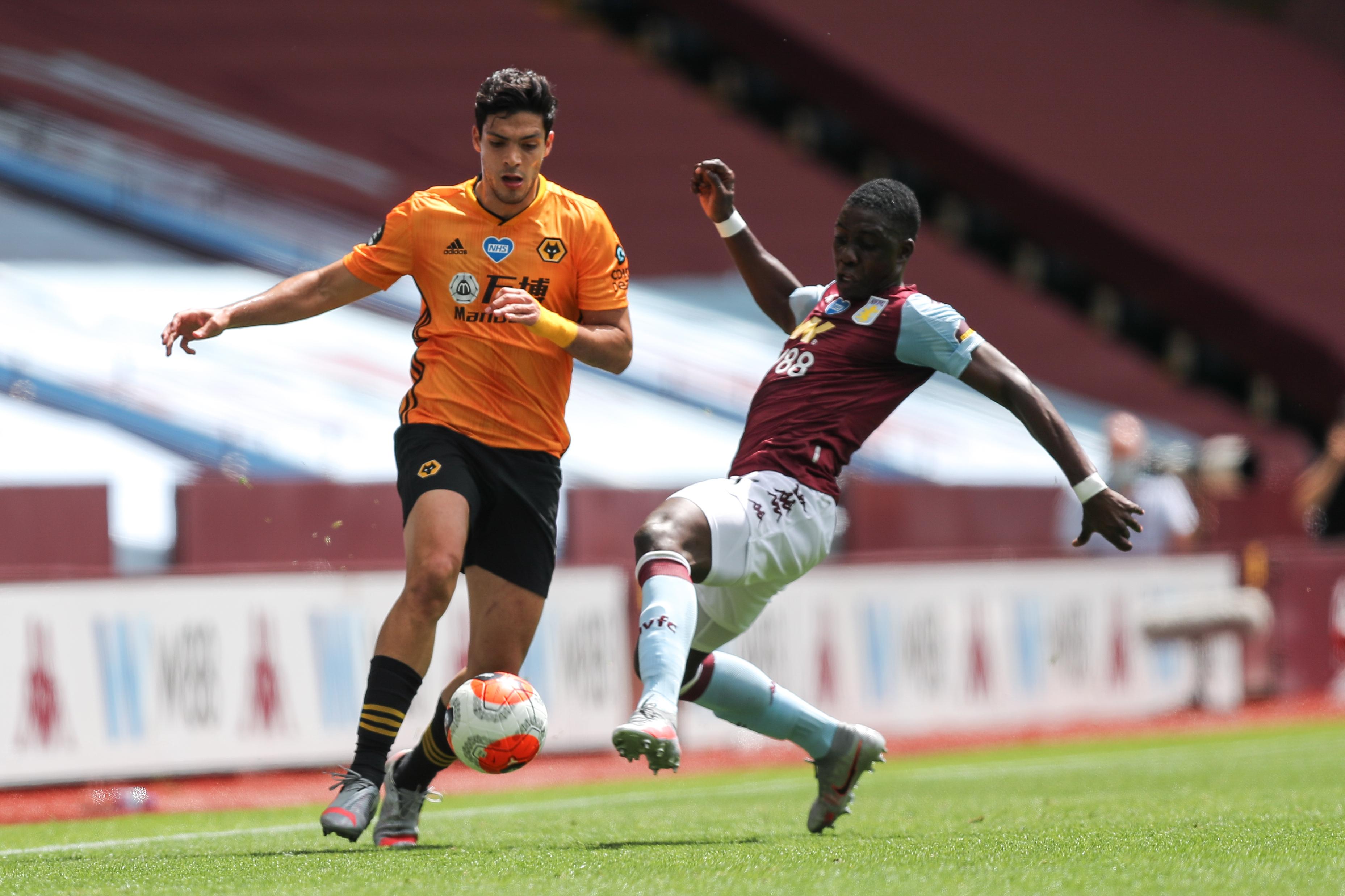 Raul Jimenez of Wolverhampton Wanderers and Ezri Konsa of Aston Villa during the Premier League match between Aston Villa and Wolverhampton Wanderers at Villa Park on June 27.