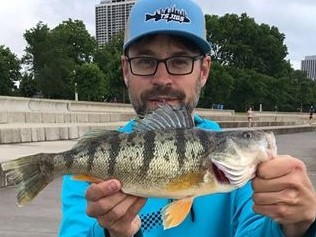 "Danny ""Taks"" Borgert shows his personal best yellow perch, caught in late June. Provided photo"
