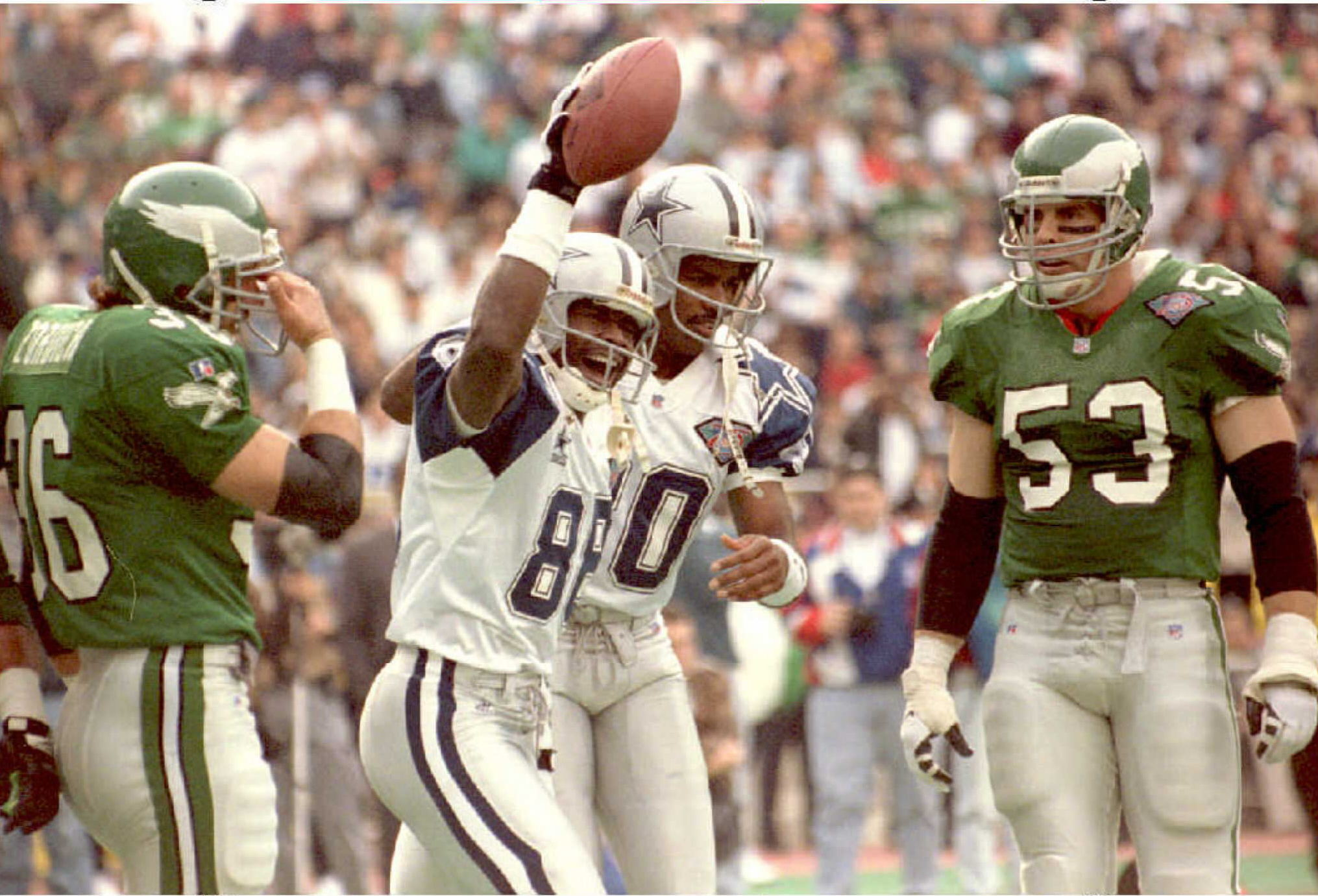 Dallas Cowboys wide-receiver Michael Irvin (2nd L)