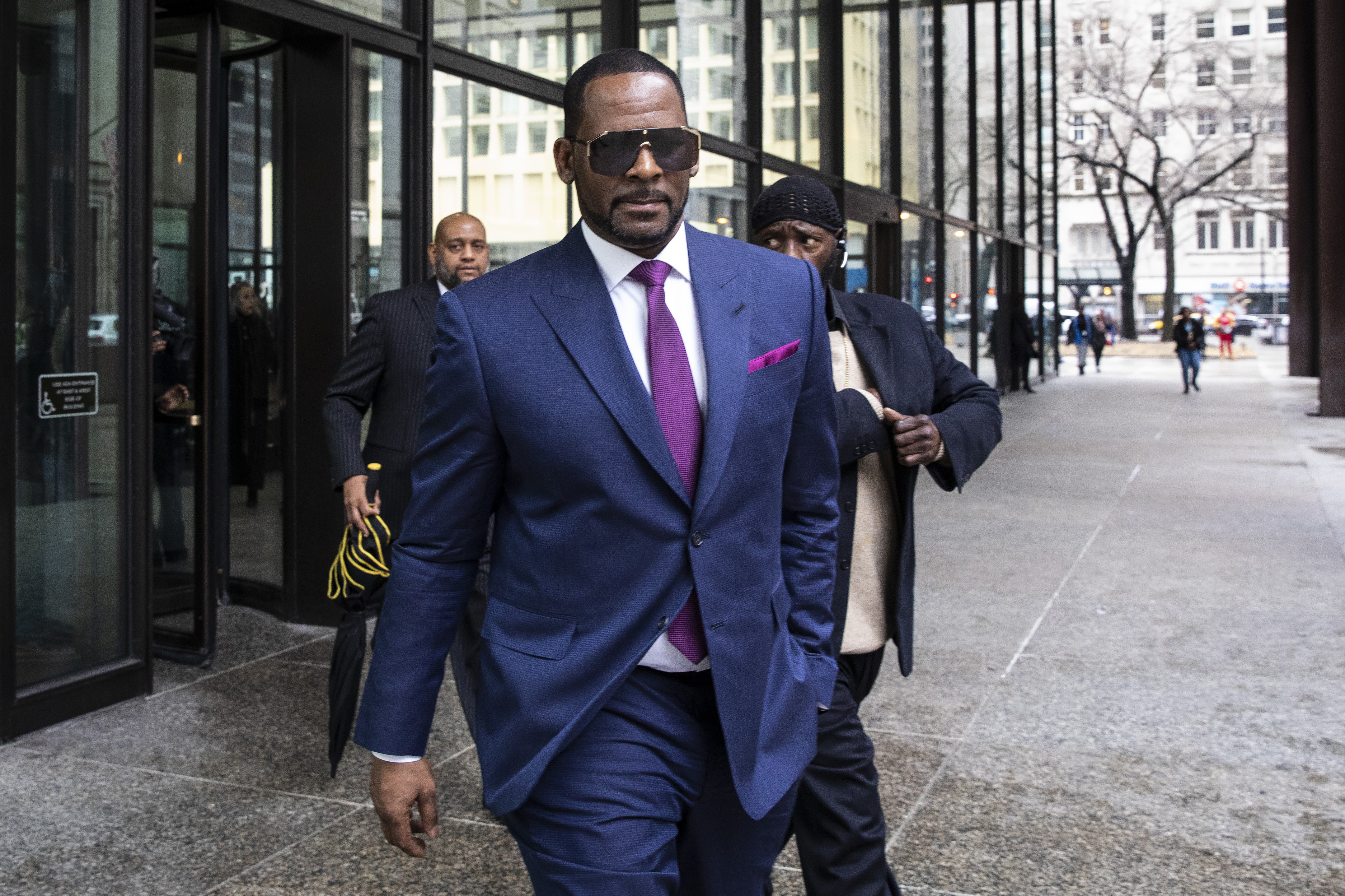 R. Kelly walks out of the Daley Center after an appearance in child support court in March 2019.