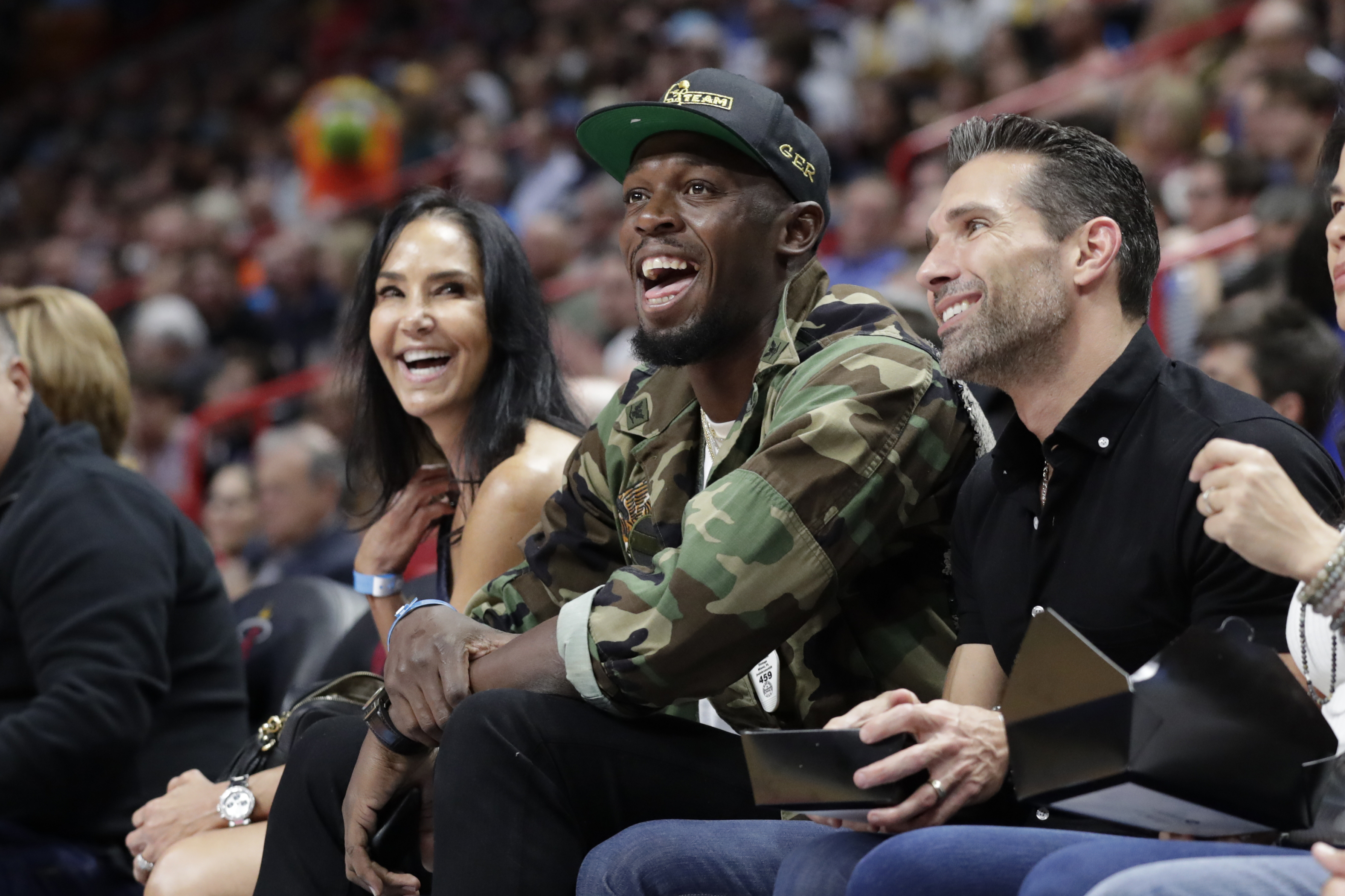 Usain Bolt watches during the first half of an NBA basketball game between the Miami Heat and Los Angeles Lakers, Friday, Dec. 13, 2019, in Miami.