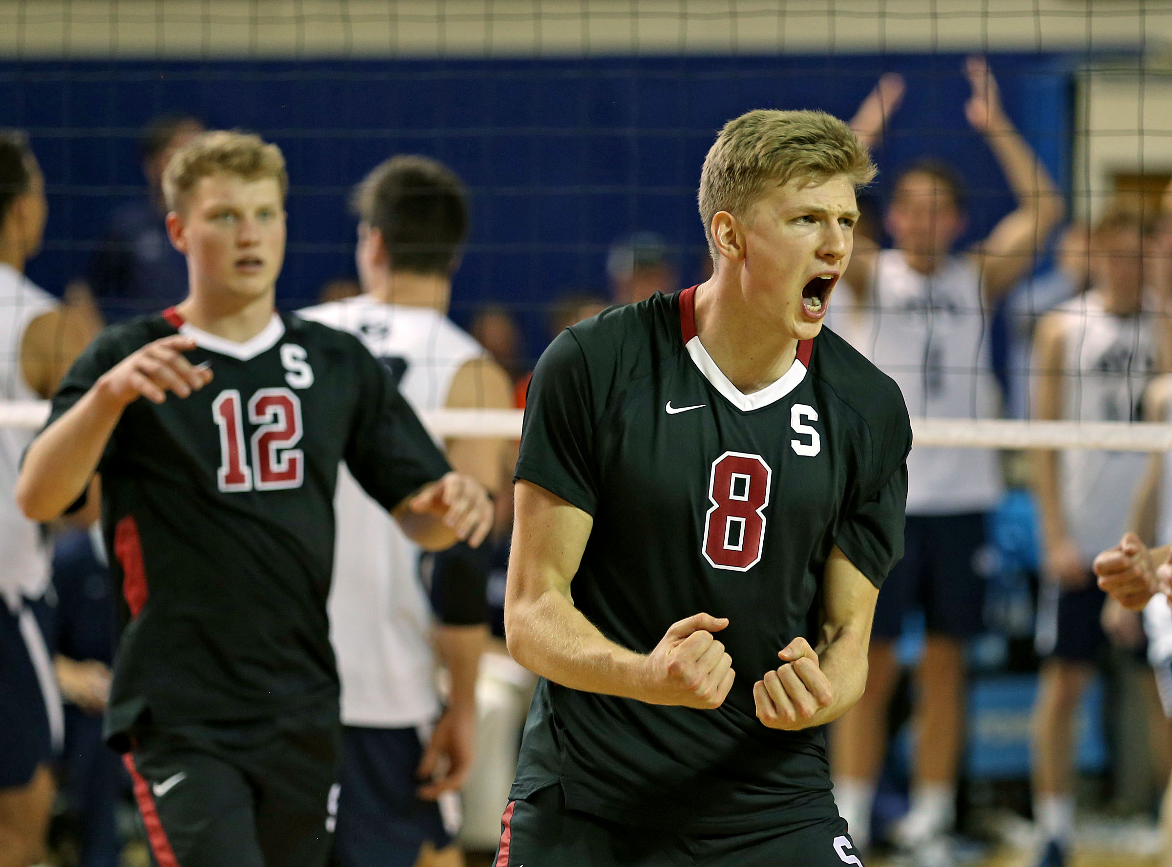 Stanford's James Shaw celebrates as the 11th ranked Stanford Cardinal defeats the top ranked BYU men's volleyball Cougars 3-2 games Friday, Jan. 15, 2016, in Provo.