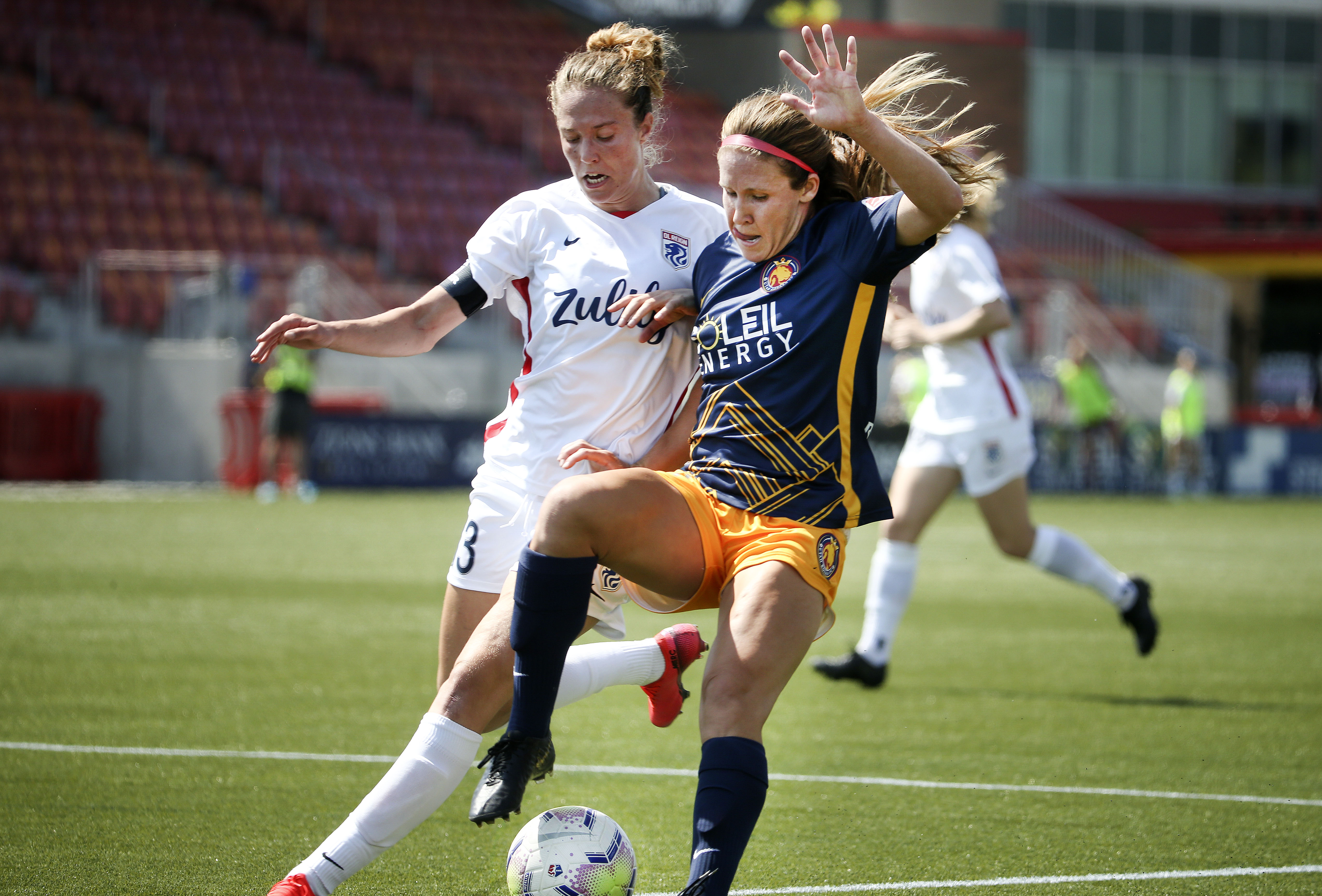 OL Reign player Celia Jimenez Delgado, left, and the Utah Royals' Mallory Weber compete for the ball in the 2020 NWSL Challenge Cup at Zions Bank Stadium in Herriman on Wednesday, July 8, 2020. The Reign won 1-0.