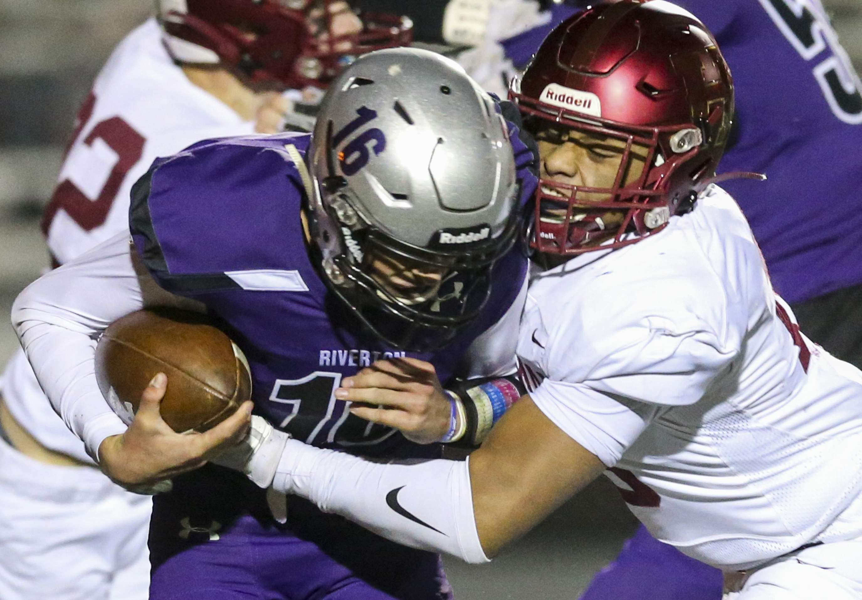 Riverton quarterback Jaxson Howard (16) is sacked on third down by Herriman lineman Ngana Leakehe (23) during the first half of a high school football game at Riverton High School in Riverton on Thursday, Oct. 17, 2019.