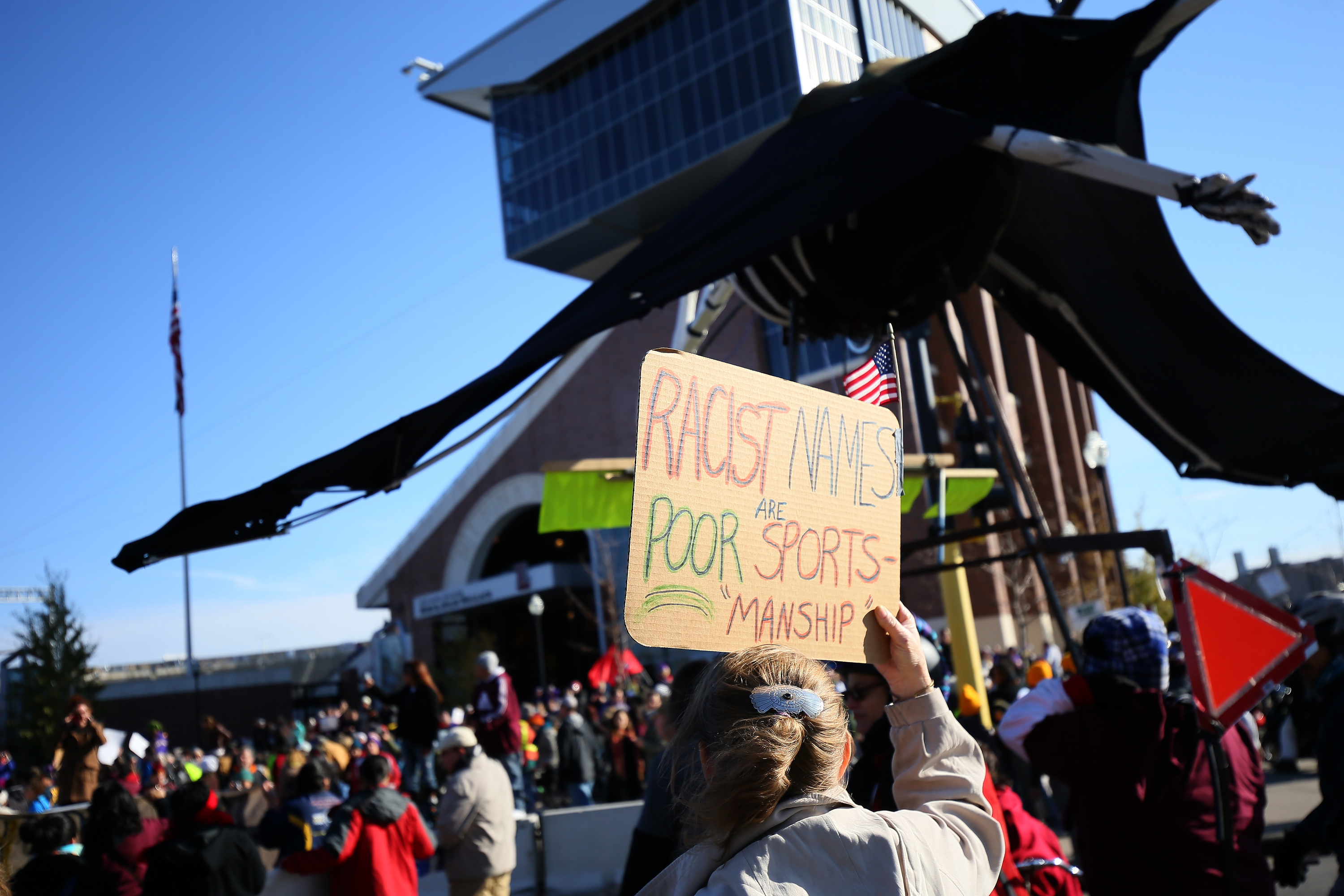 Protesters demonstrate at a Washington Redskins game in 2014.