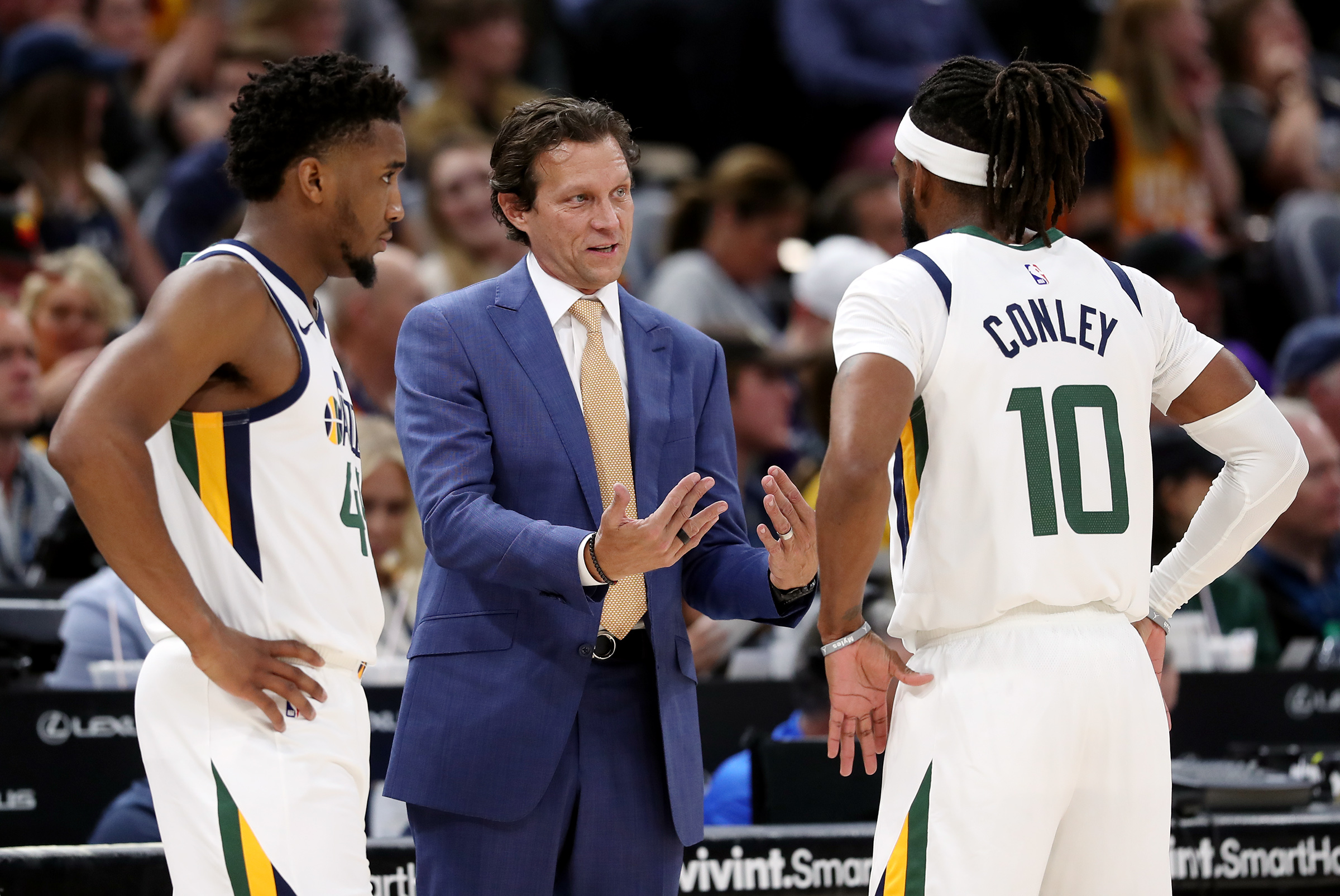 Utah Jazz coach Quin Snyder talks with Utah Jazz guard Donovan Mitchell (45) and Utah Jazz guard Mike Conley (10) as the Utah Jazz and the Portland Trail Blazers play at Vivint Smart Home Arena in Salt Lake City on Wednesday, Oct. 16, 2019.