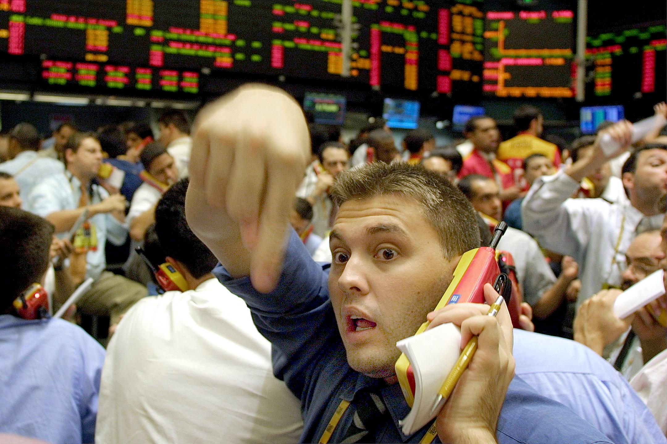 Stock market operators negotiate trades in Sao Pau