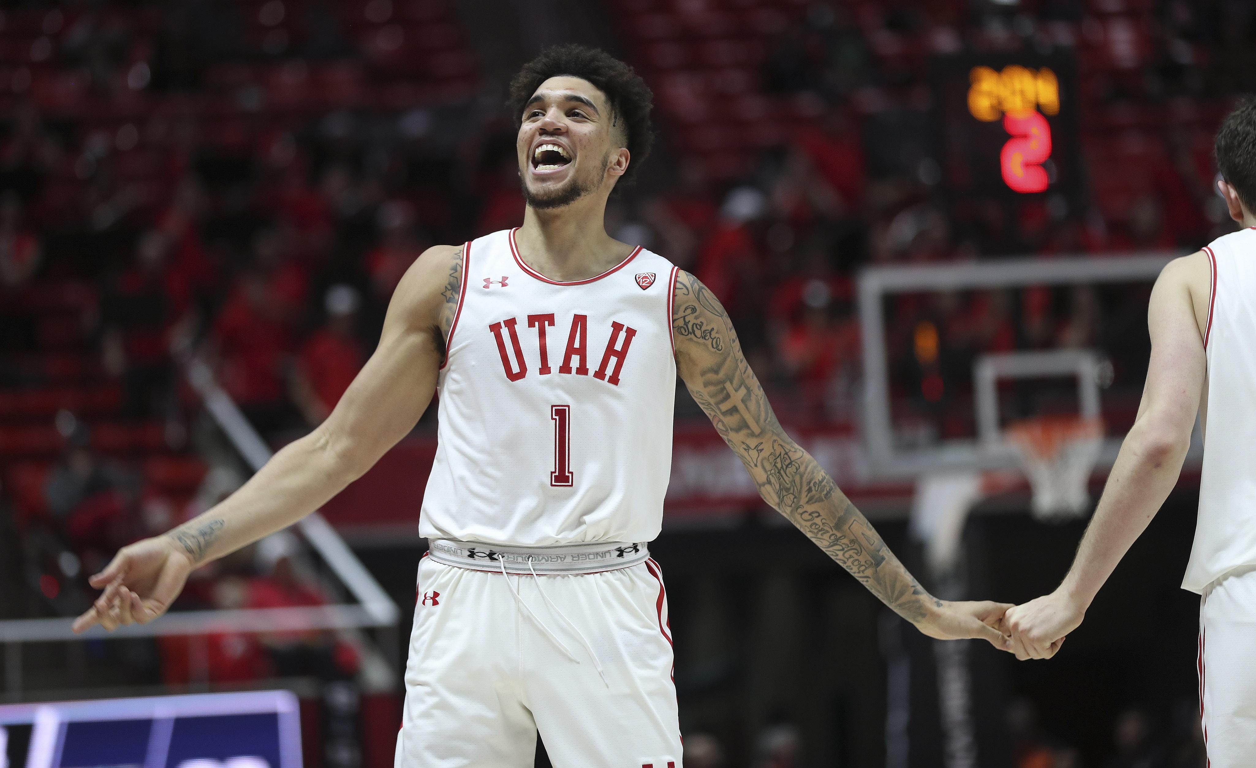 Utah Utes forward Timmy Allen (1) celebrates a basket near the end of the game with the Washington Huskies in Salt Lake City on Thursday, Jan. 23, 2020. The Utes won 67-66.