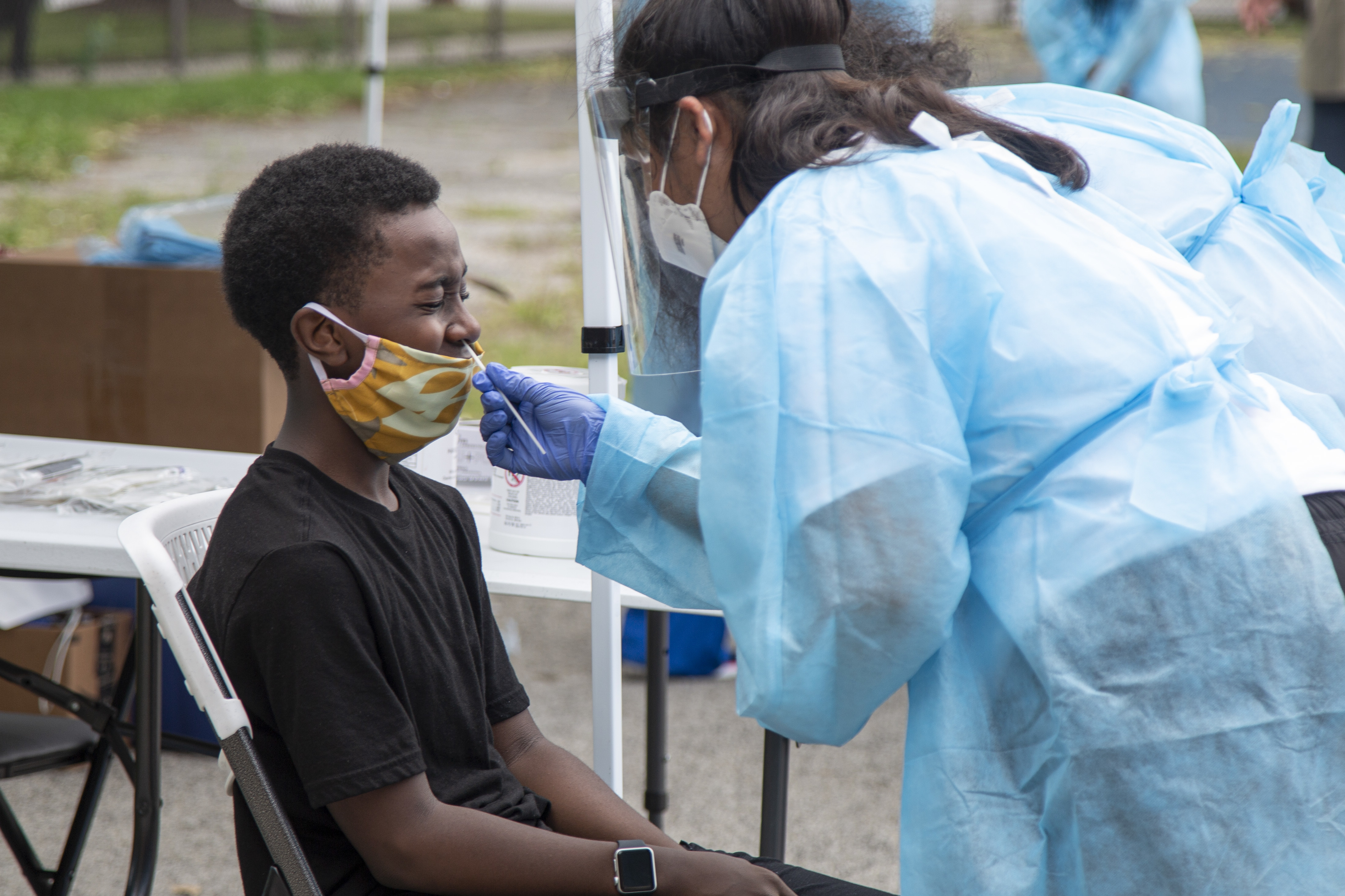 Jabari Leeper gets tested for COVID-19 at a mobile COVID-19 testing station at Edward Coles School at 8441 S. Yates Blvd. in South Chicago, Wednesday, July 8, 2020.