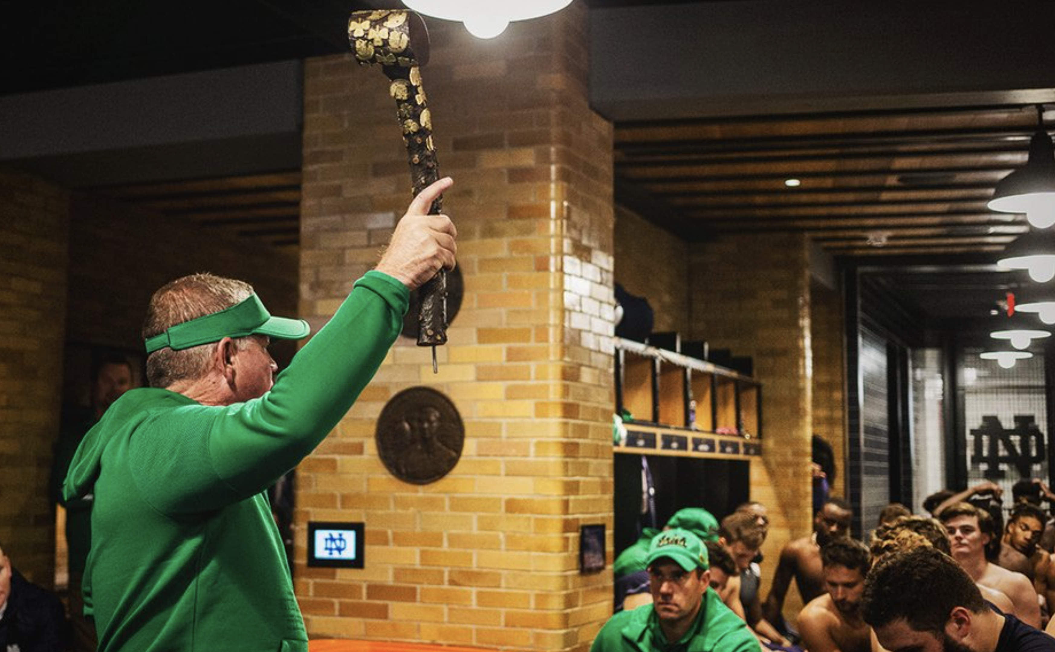 Notre Dame coach Brian Kelly hoists Jeweled Shillelagh after win over USC