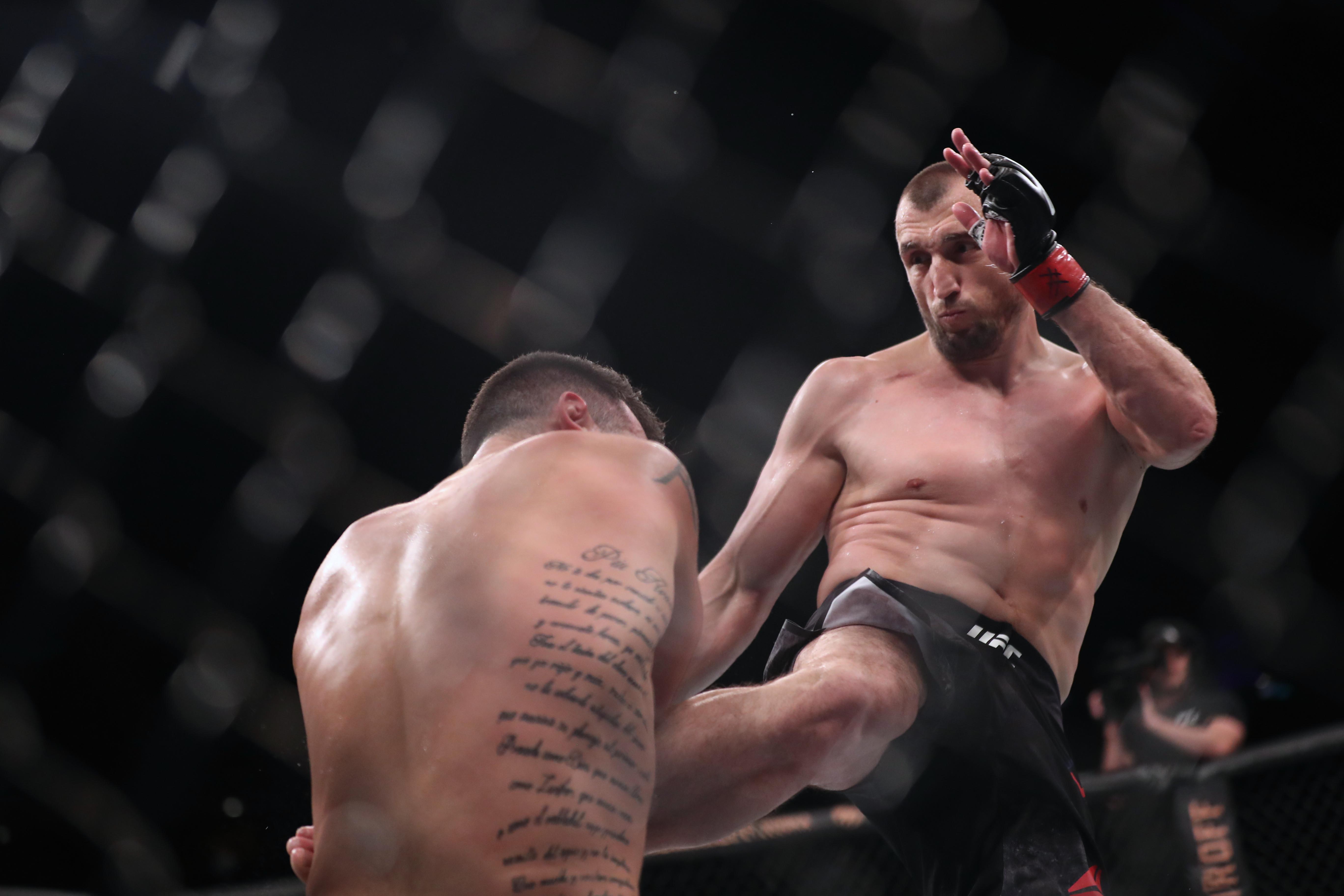 Muslim Salikhov (red gloves) fights Laureano Staropoli (blue gloves) during UFC Fight Night at Singapore Indoor Arena in October 2019.