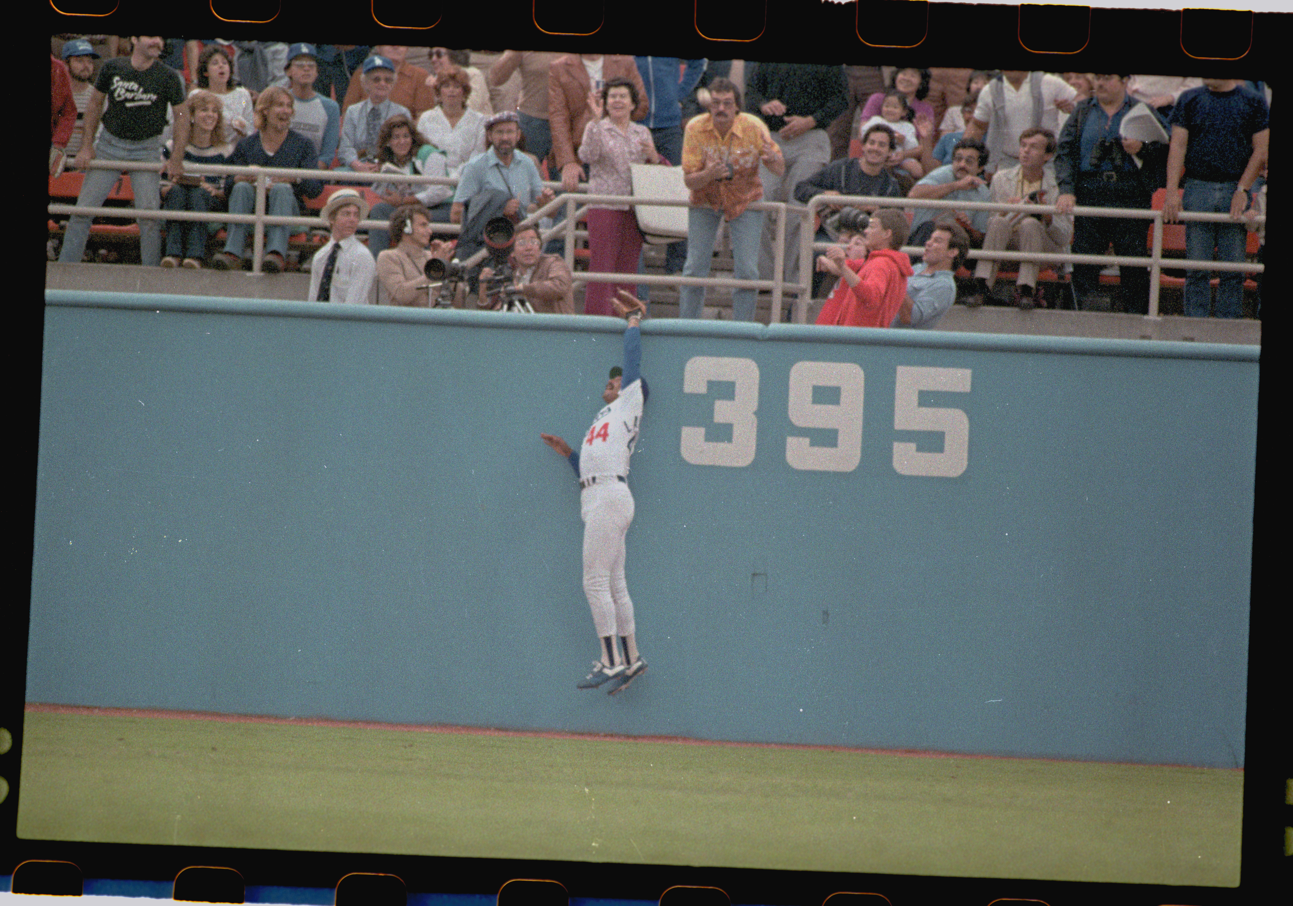 Kenny Landreaux Going up to Catch Ball