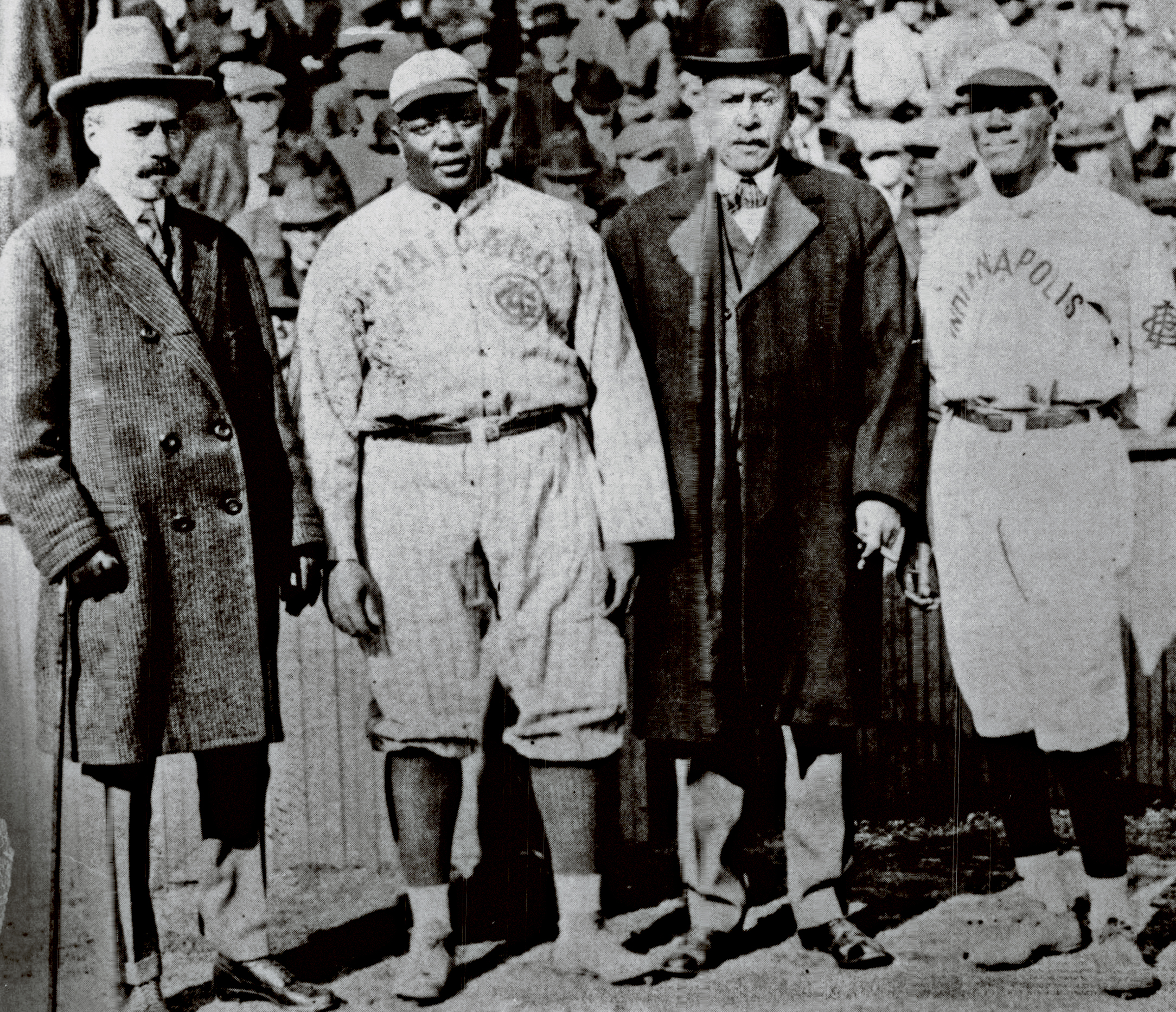 Rube Foster (pictured second from left in a rare postcard photo) was pitcher, then manager of a team he organized, the Chicago American Giants, in the Negro National League, which he founded.