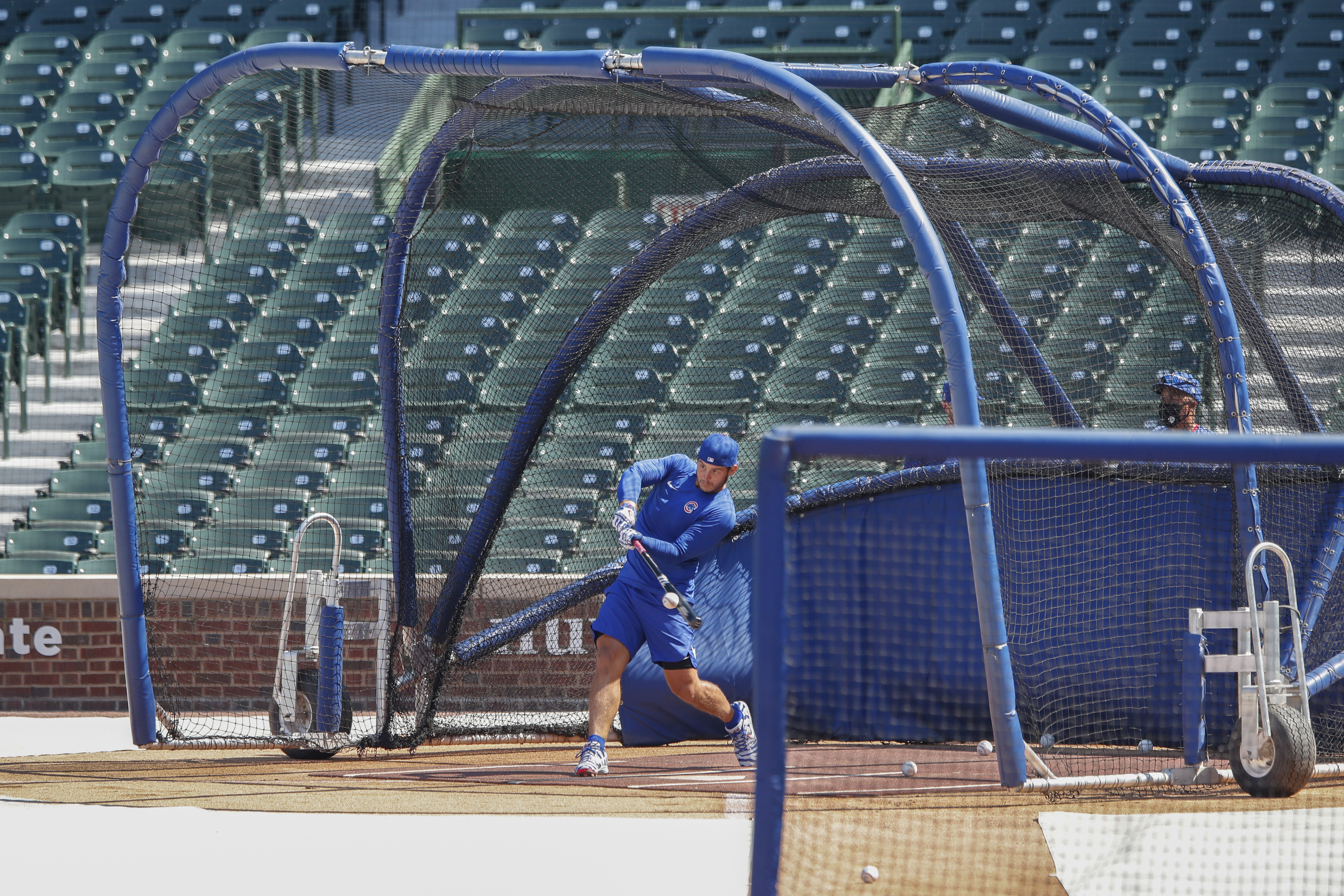 Cubs first baseman Anthony Rizzo bats during baseball practice at Wrigley Field.