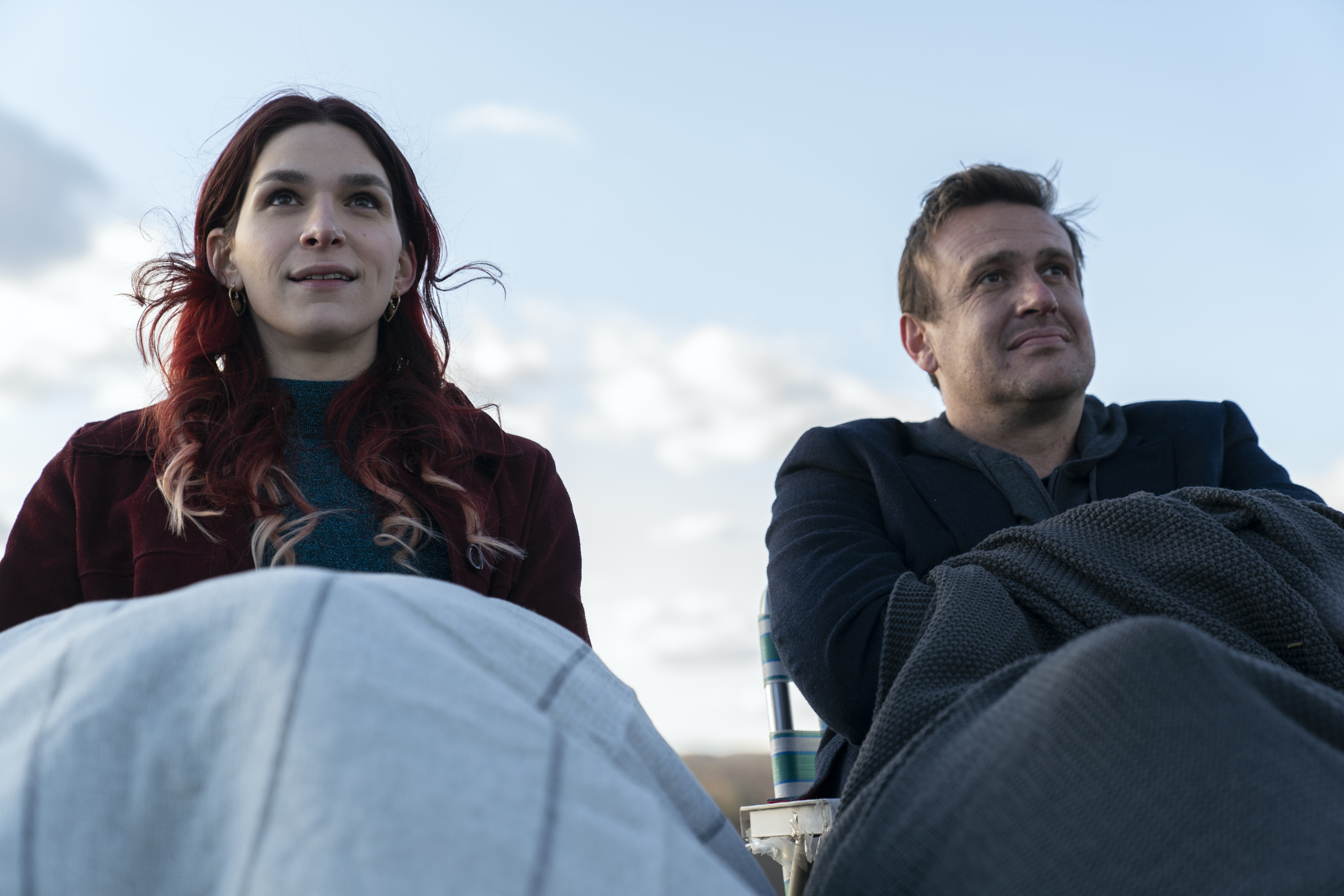 Simone and Peter sit on a rooftop.