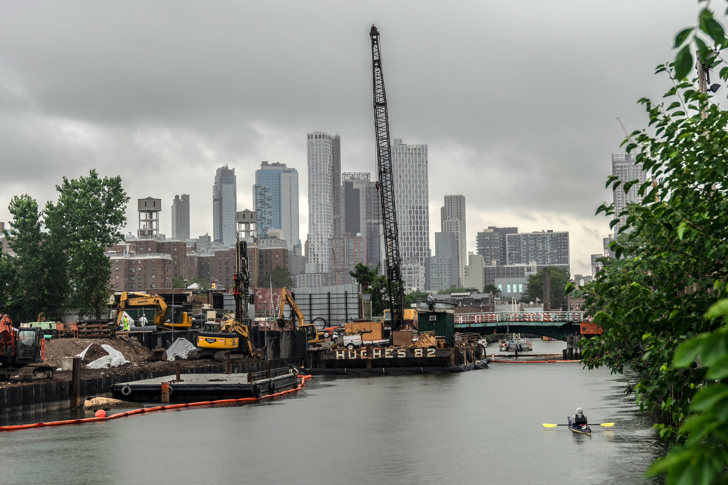 A person kayaks toward construction on the Gowanus Canal, July 10, 2020.