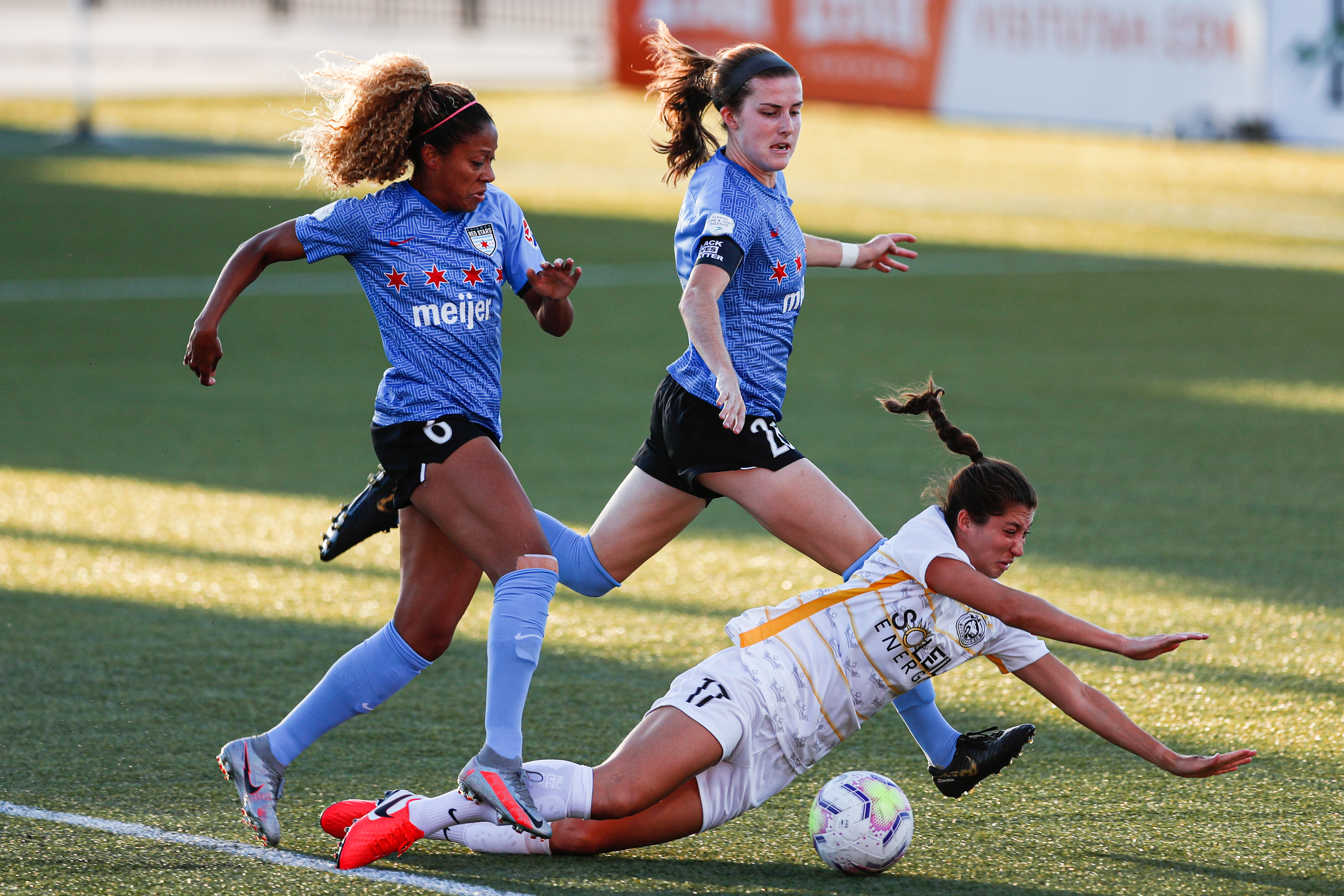 Chicago Red Stars defender Casey Short (6) and Tierna Davidson (26) attempt to stop Utah Royals FC forward Arielle Ship (17) during a National Women Soccer League soccer game at Zions Bank Stadium in Herriman on Sunday, July 12, 2020.