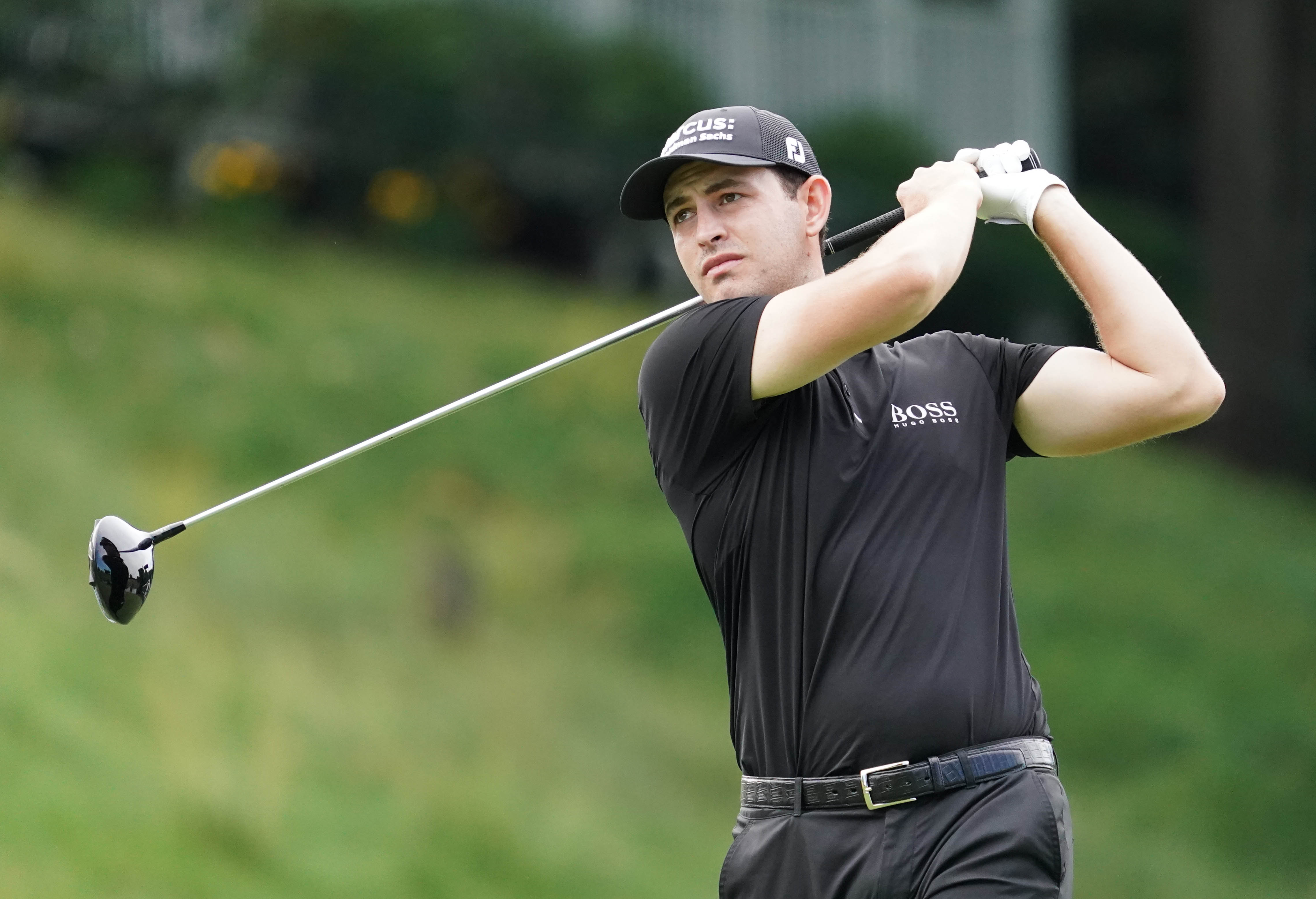 Patrick Cantlay hits his tee shot on the 18th hole during the first round of the Travelers Championship golf tournament at TPC River Highlands.
