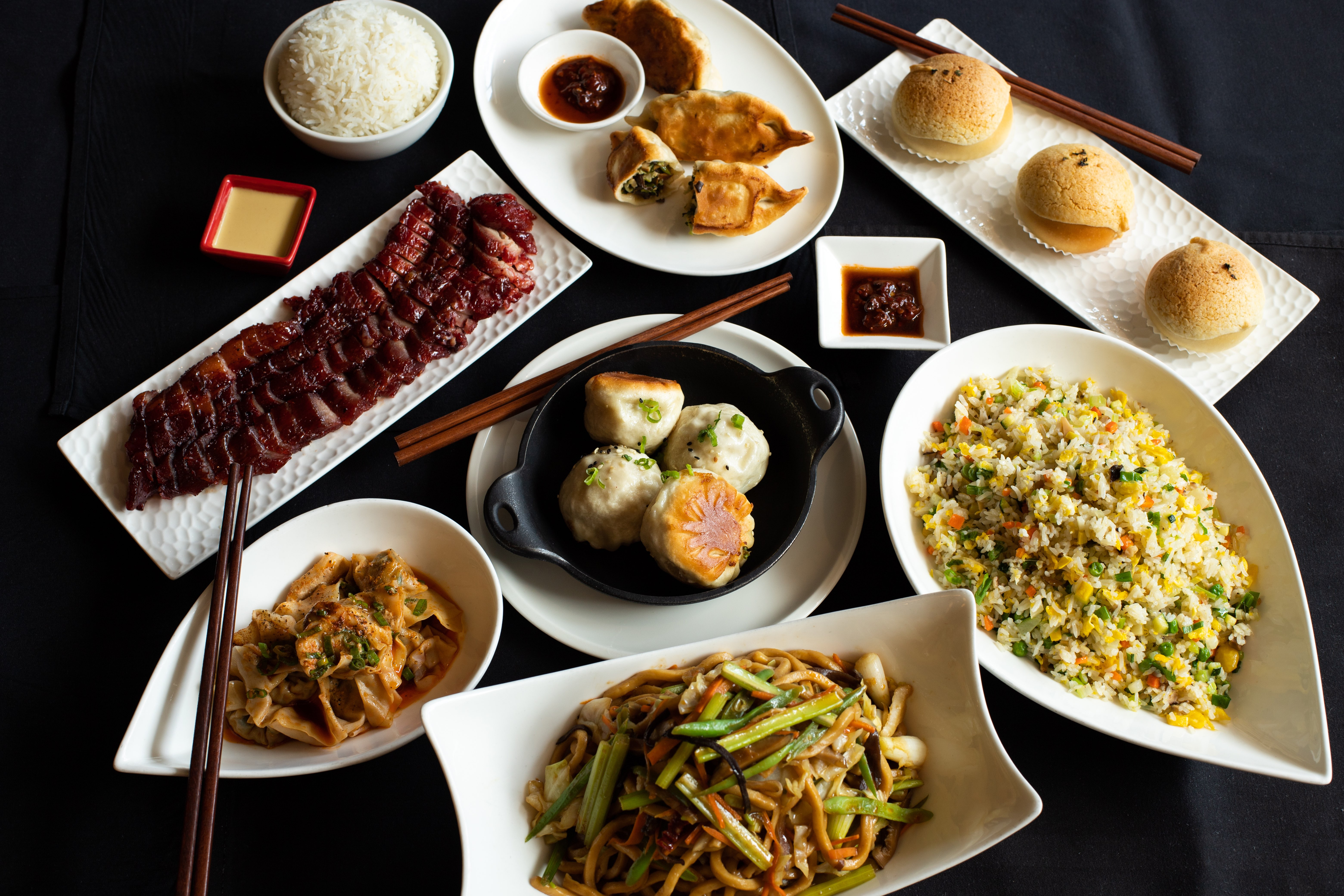 A lineup of the China Live dishes that will be available for takeout via its new ghost kitchen collaboration — including its sheng jian bao, roast pork, barbecue pork buns, and fried rice