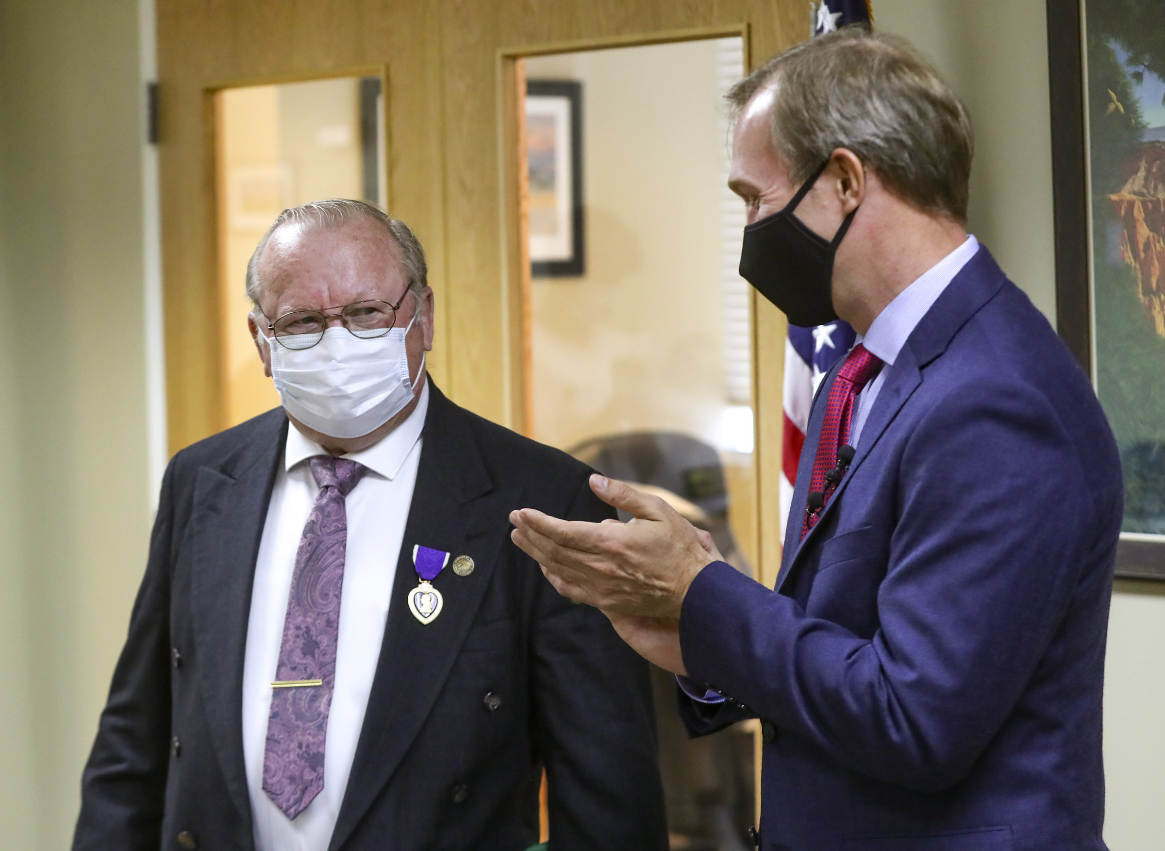 Douglas W. Evans smiles from under his mask after being presented the Purple Heart by Utah Rep. Ben McAdams, D-Utah, at McAdams' office in West Jordan on Monday, July 13, 2020. Evans received the award for wounds suffered during the Vietnam War. McAdams' staff worked with the Department of Defense on behalf of the Evans family to untangle a paperwork issue that for 50 years prevented the medal citation from being included in his official Army record.