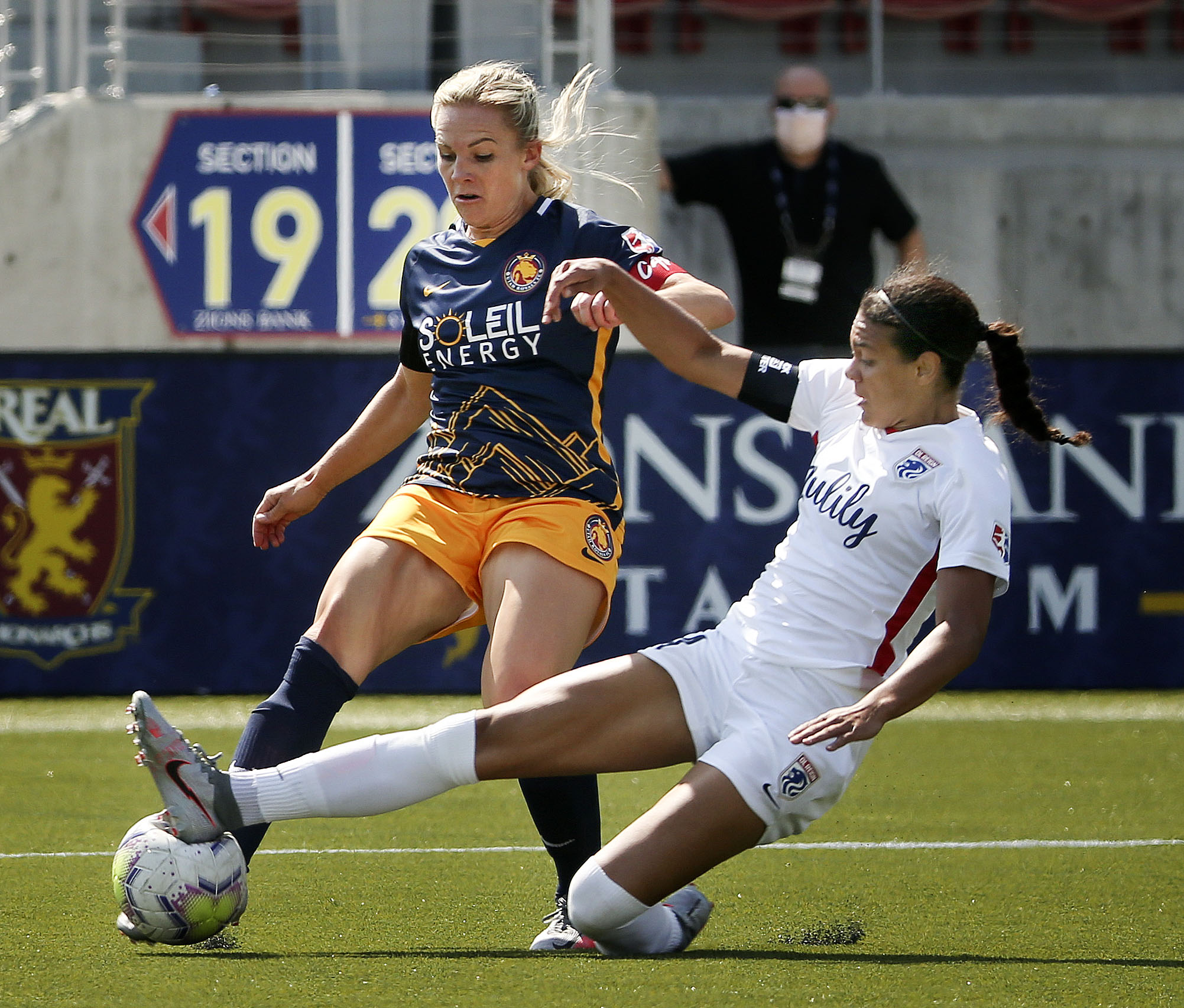 Utah Royals player Amy Rodriguez is stopped by OL Reign defender Alana Cook in a 2020 NWSL Challenge Cup game at Zions Bank Stadium in Herriman on Wednesday, July 8, 2020.