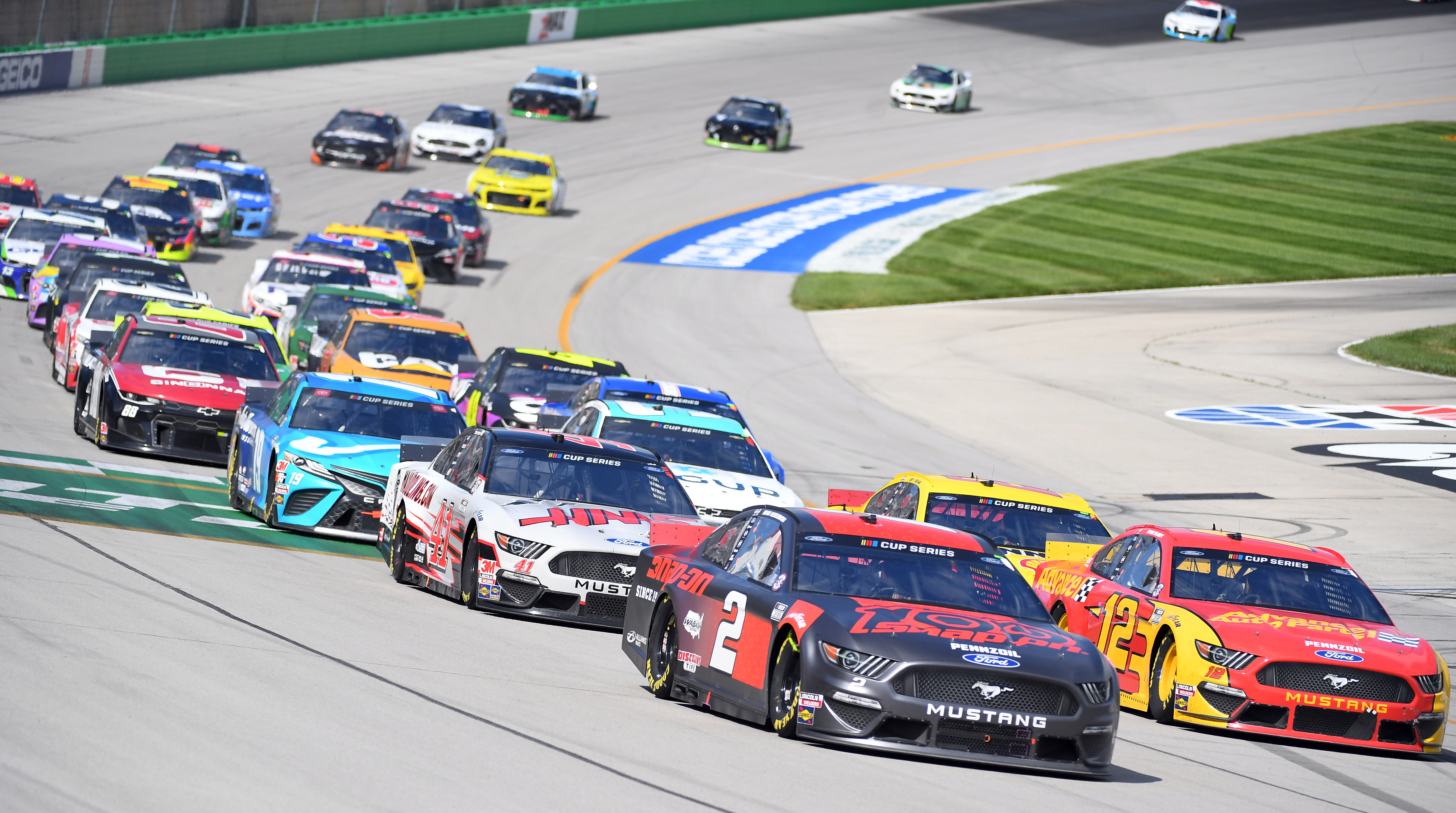 Monster Energy NASCAR Cup Series driver Brad Keselowski leads Monster Energy NASCAR Cup Series driver Ryan Blaney and Monster Energy NASCAR Cup Series driver Cole Custer on a restart during the Quaker State 400 at Kentucky Speedway.