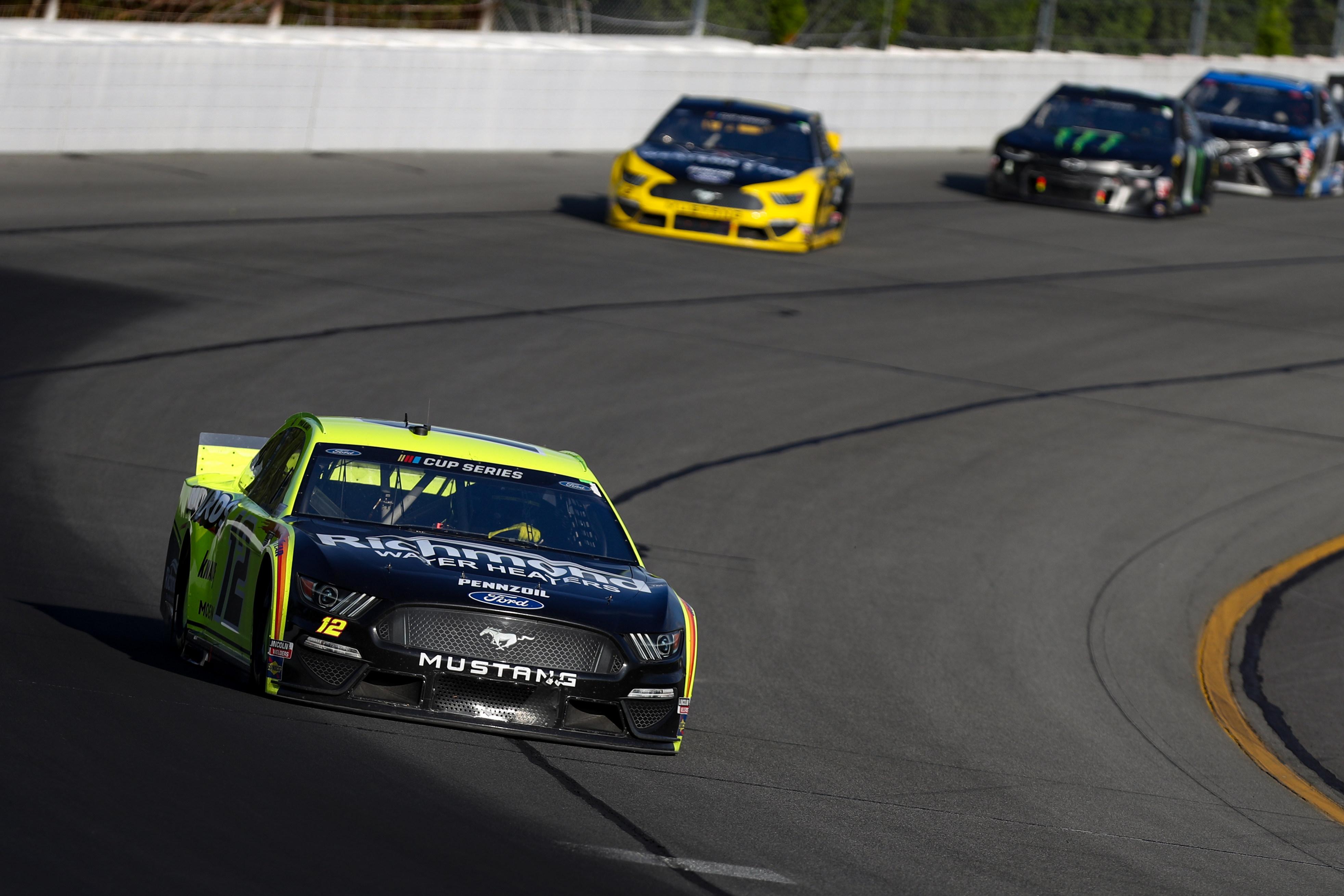 NASCAR Cup Series driver Ryan Blaney leads driver Brad Keselowski during the Pocono 350 at Pocono Raceway.
