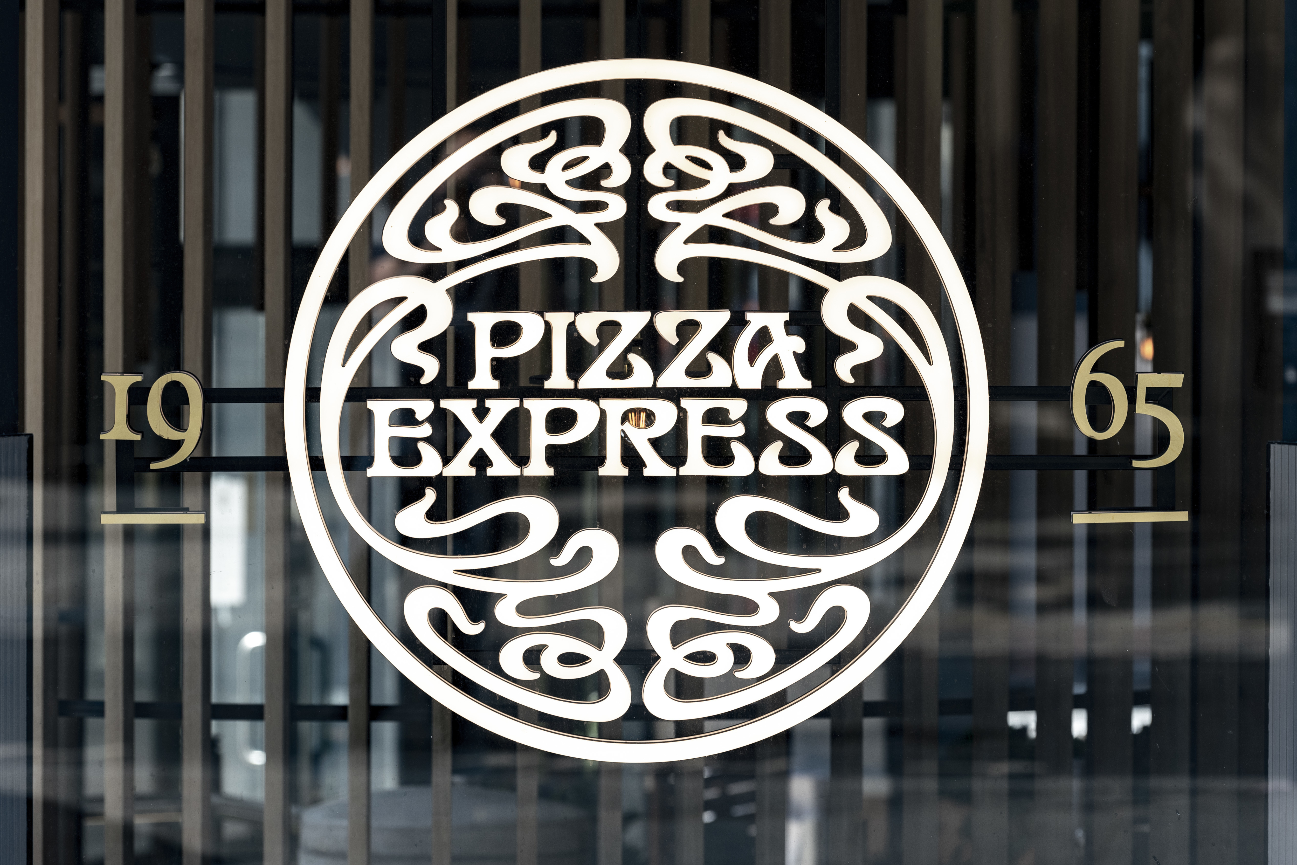 Pizza Express logo in a window on their restaurant in the U.K.