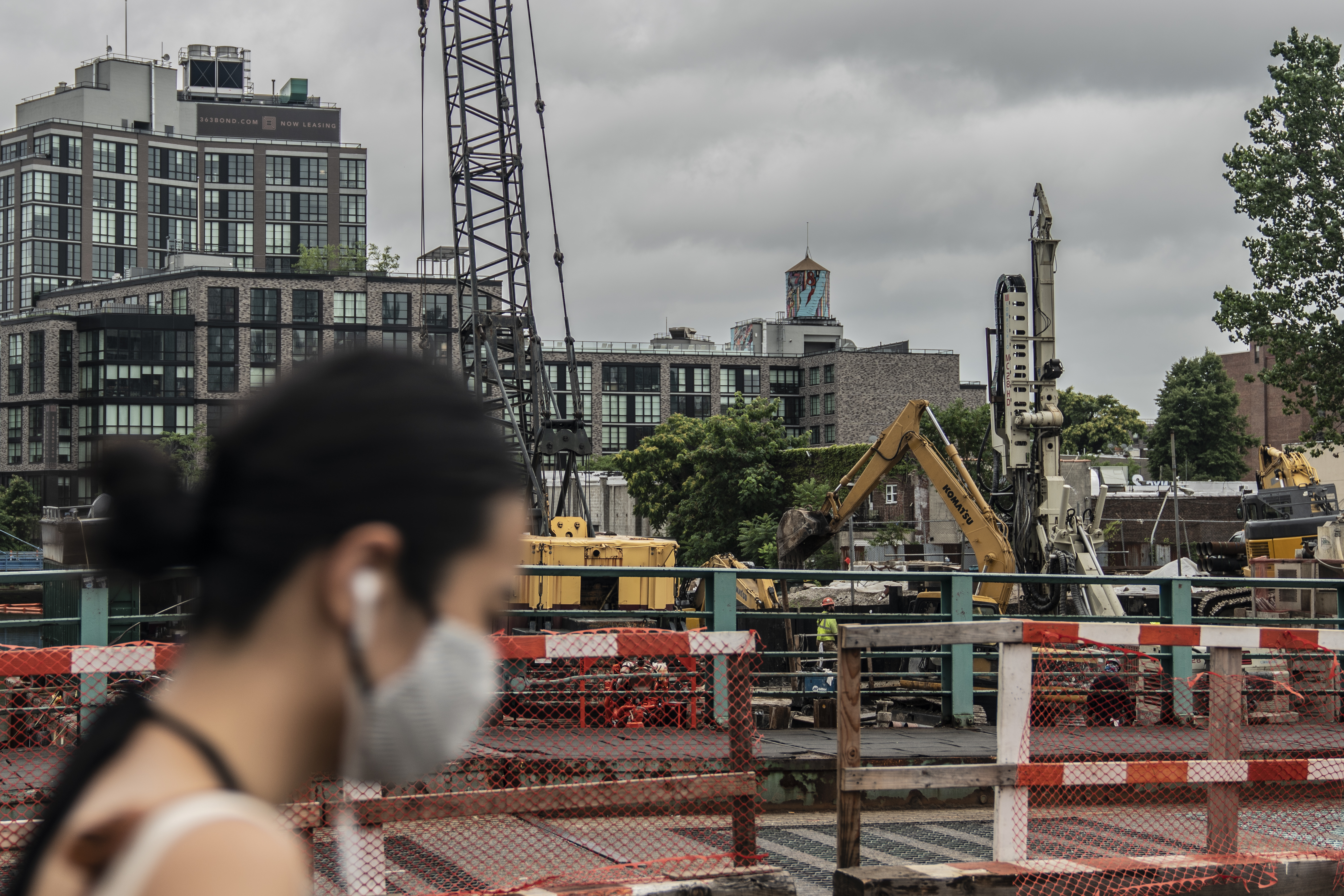 A person walks past construction around the Gowanus Canal, July 10, 2020.