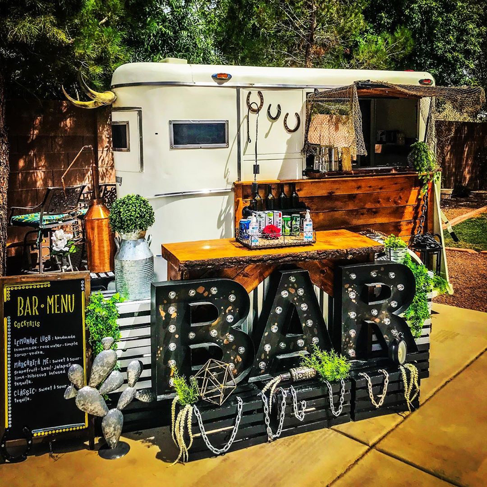 One of the Horse Trailer Hideout's mobile bars, headed to a speakeasy event space on Main Street.