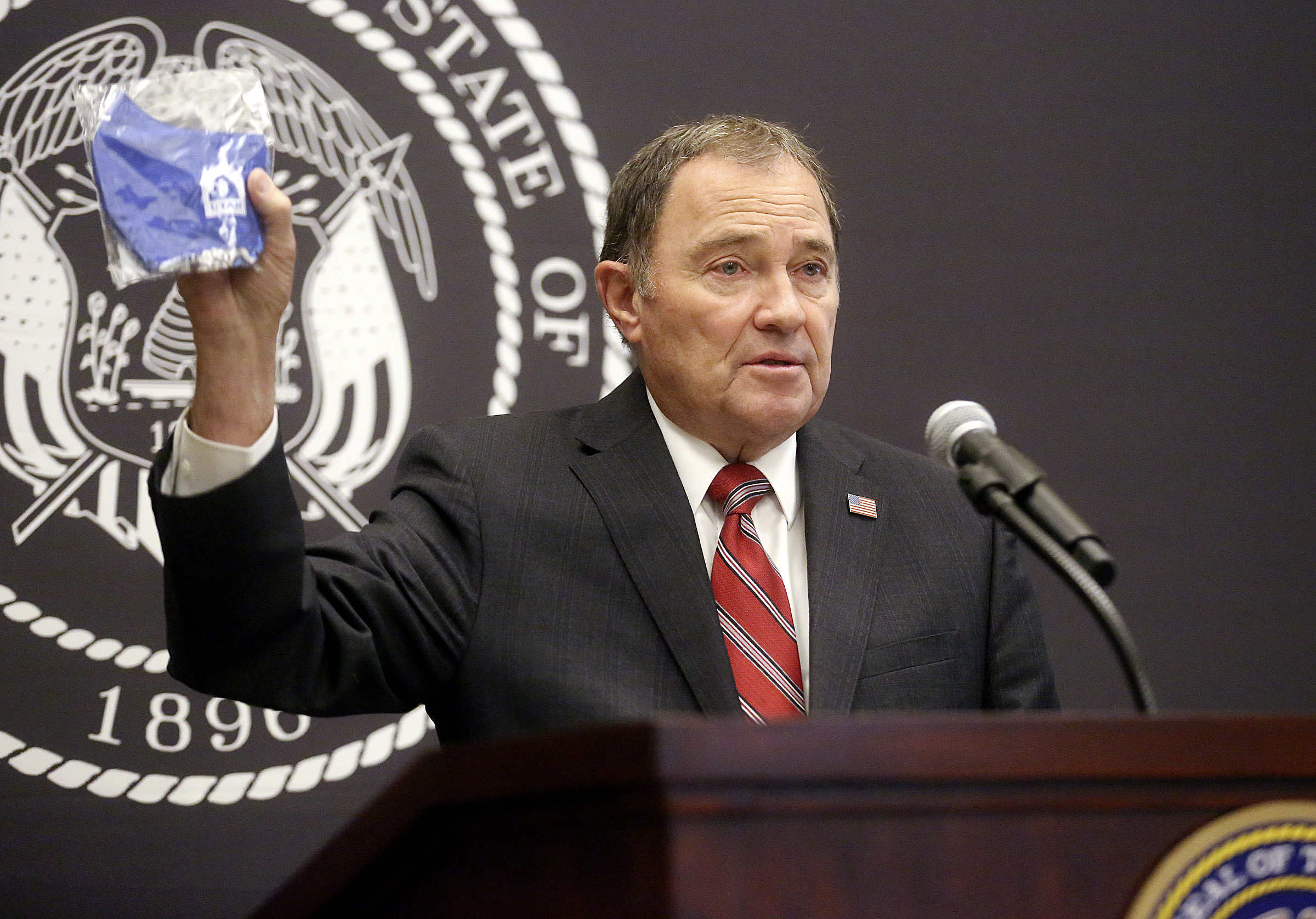Gov. Gary Herbert holds a face mask during a COVID-19 briefing at the Capitol in Salt Lake City on Thursday, July 16, 2020. Herbert announces face coverings will be provided to K-12 students when they return to the classroom.