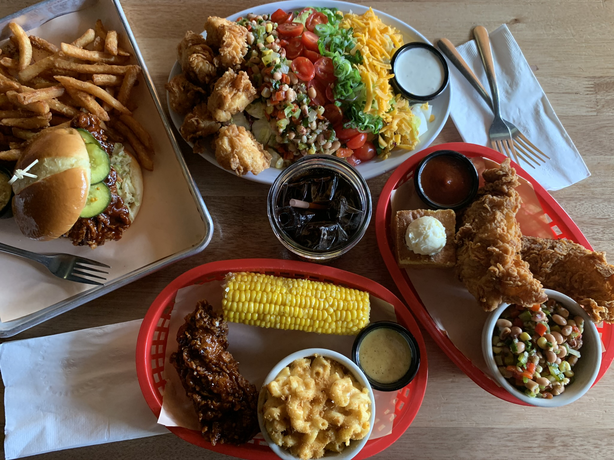 Fried chicken tenders, a fried chicken sandwich, a salad, and a selection of sides at Jack's Chicken Shack