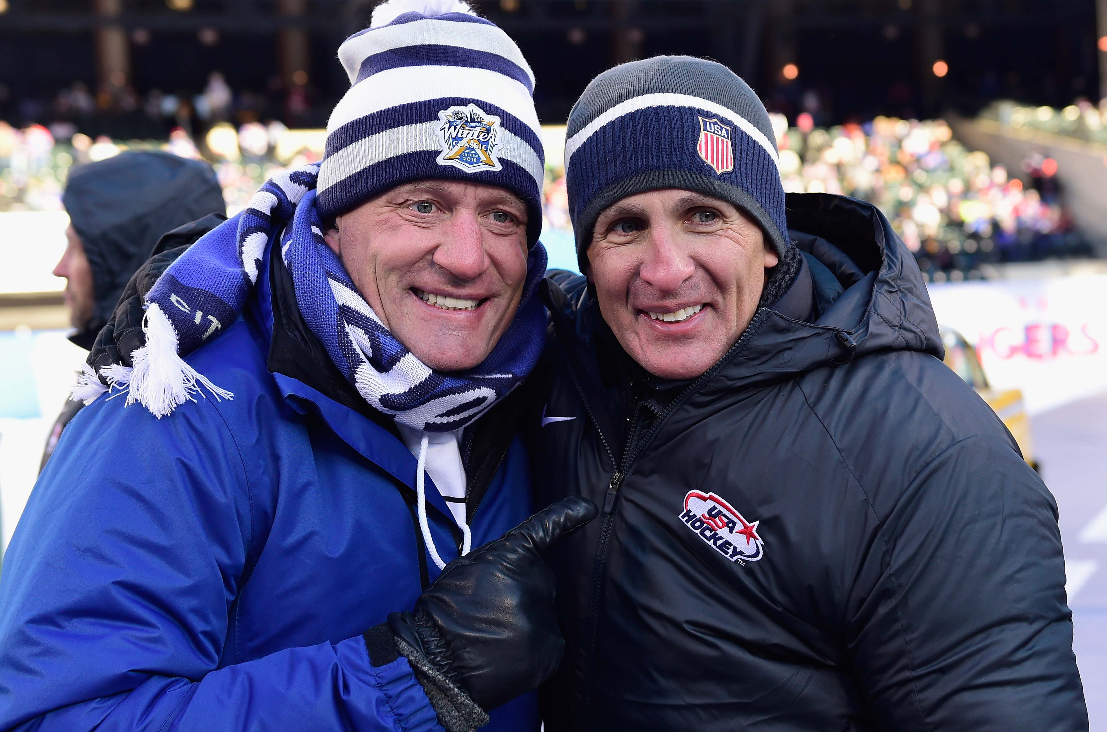 NEW YORK, NY - JANUARY 01: Sportcaster Jeremy Roenick (L) poses with Tony Granato of USA Hockey (R) during the second intermission of the 2018 Bridgestone NHL Winter Classic between the New York Rangers and the Buffalo Sabres at Citi Field on January 1, 2018 in the Flushing neighborhood of the Queens borough of New York City.
