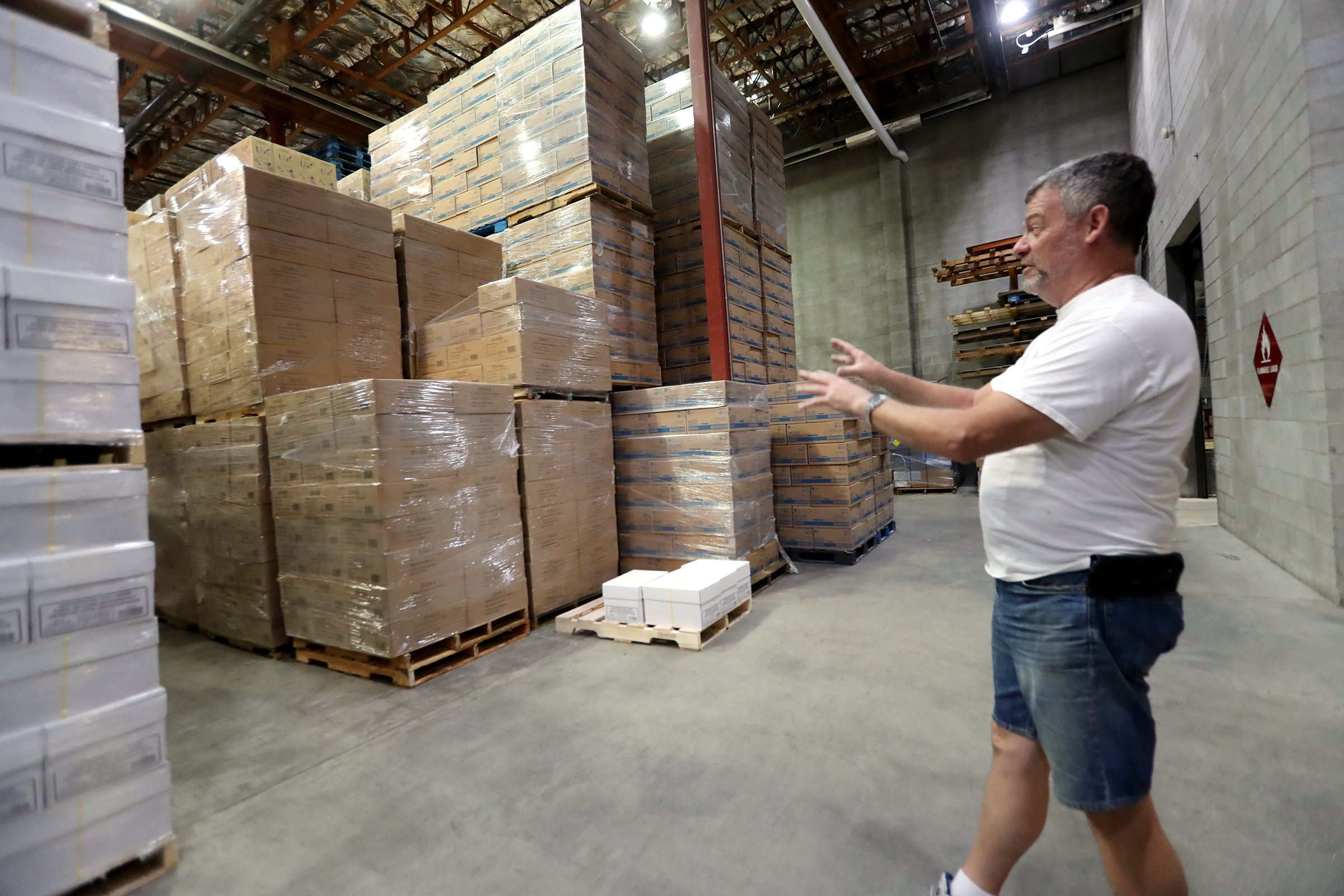 Joe Mortensen, warehouse leadman, shows some of the COVID-19 supplies being storied at the Granite School District warehouse in South Salt Lake on Friday, July 17, 2020. The items will be distributed when schools reopen.