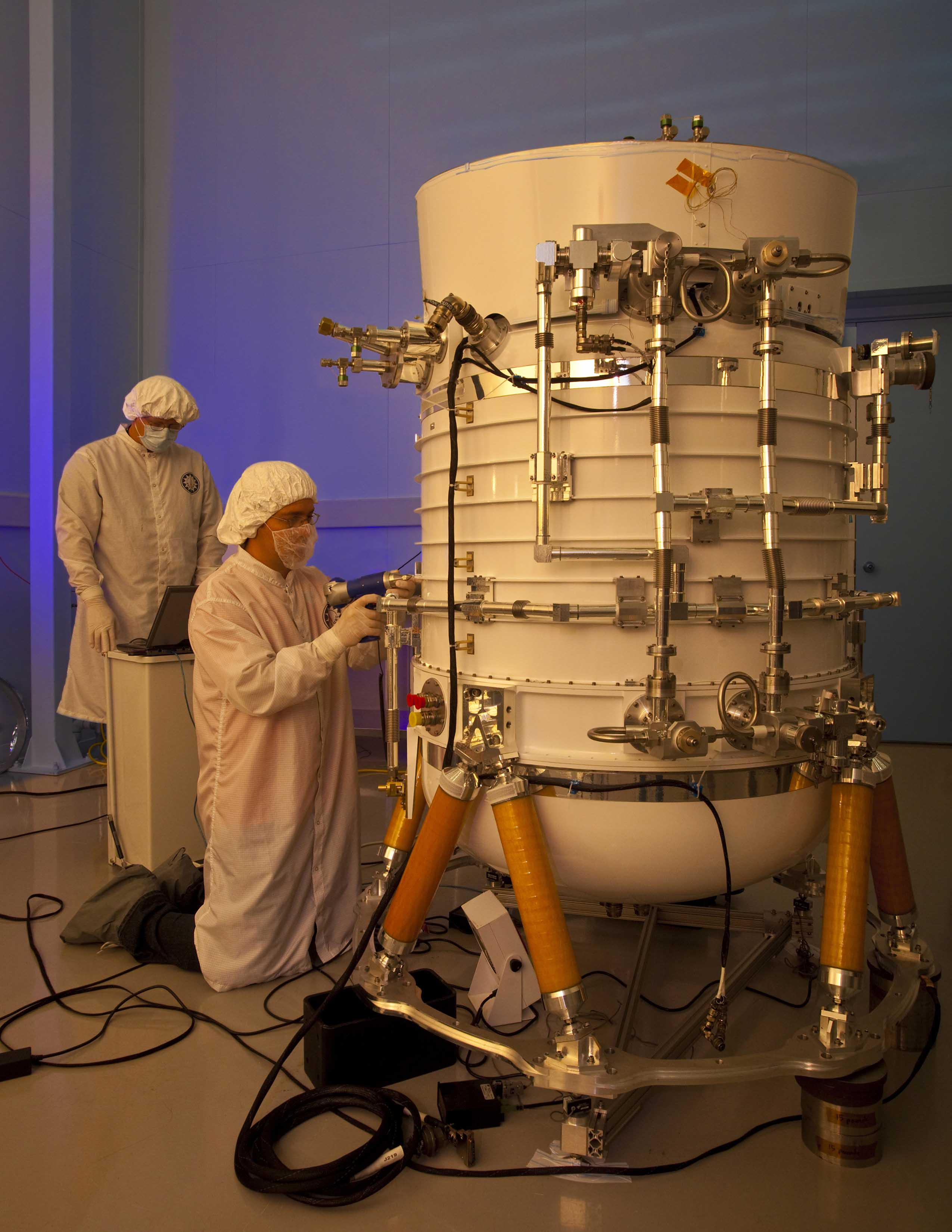 In this 2009 photograph, Space Dynamics Laboratory engineers prepare the Wide‐field Infrared Survey Explorer — or WISE — telescope at the lab's North Logan facility for shipment and launch. Following its successful first mission, WISE was renamed Near-Earth Object WISE, or NEOWISE.