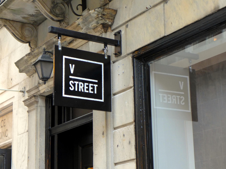 restaurant sign that says v street