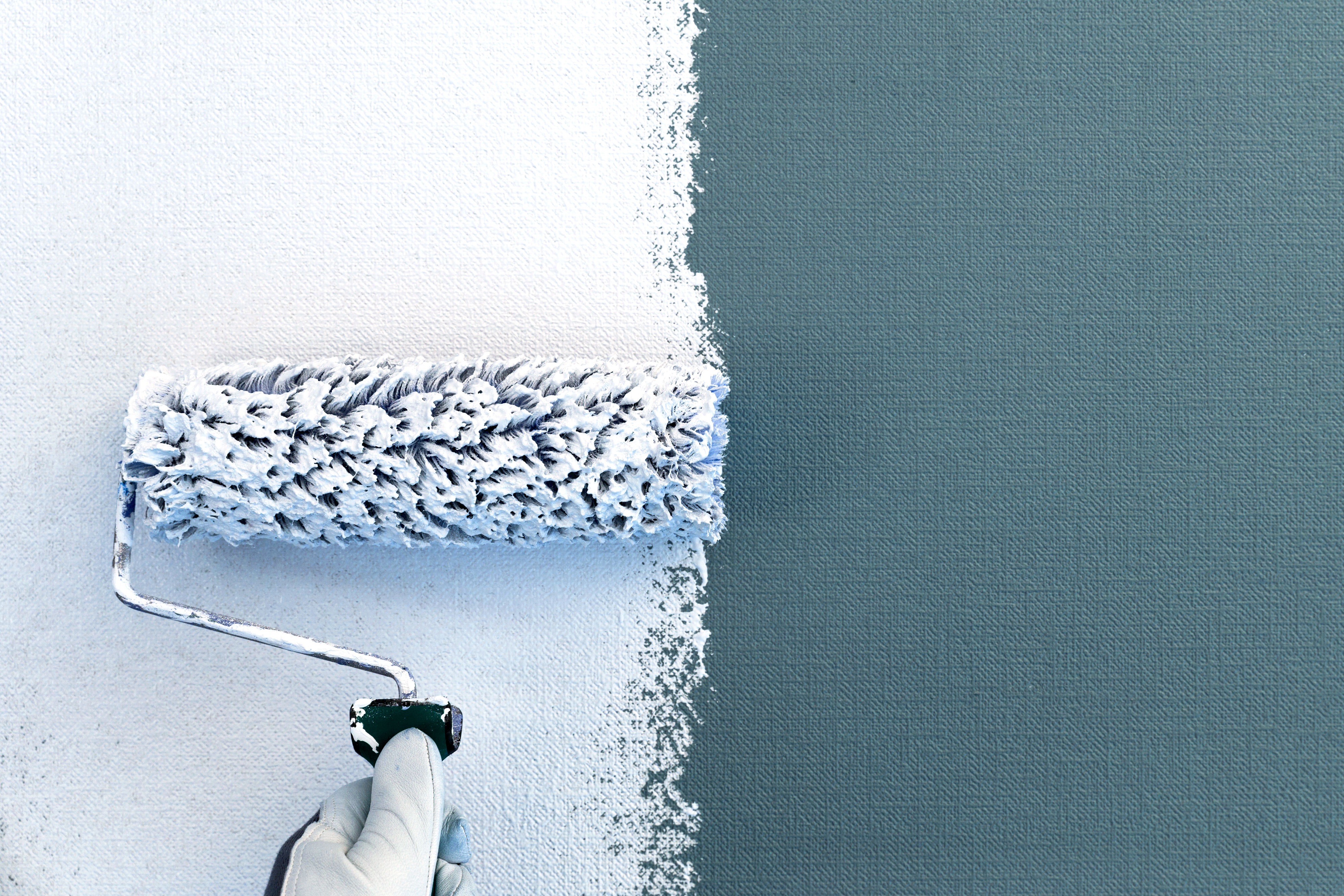 Paint Over Wallpaper with a roller brush.