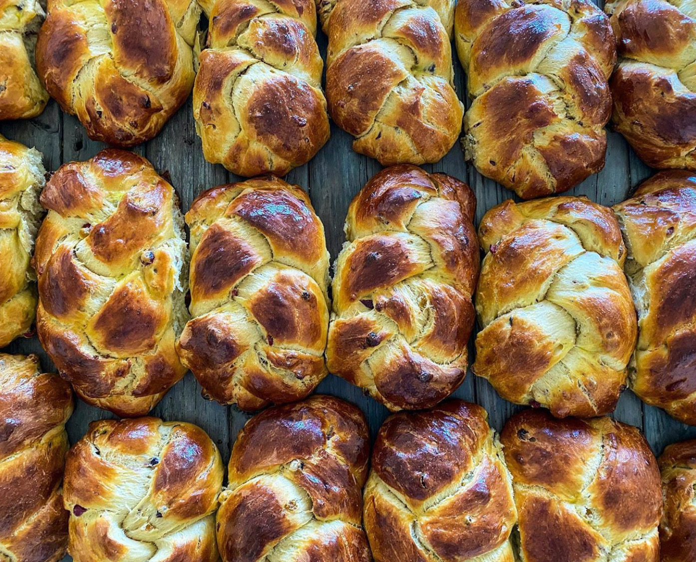Baked challah shown from above, with golden edges.