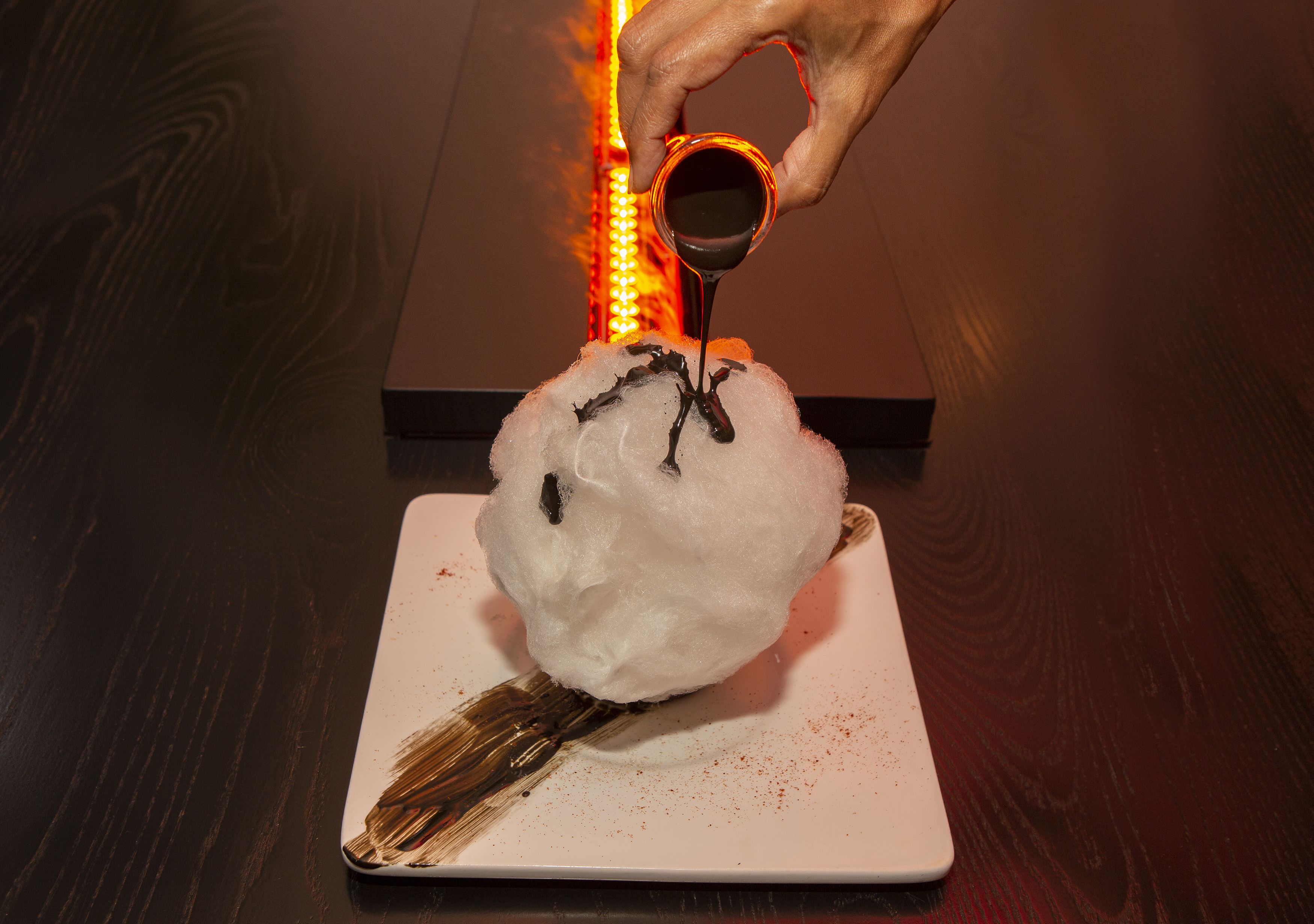 A dessert with chocolate sauce poured on top.