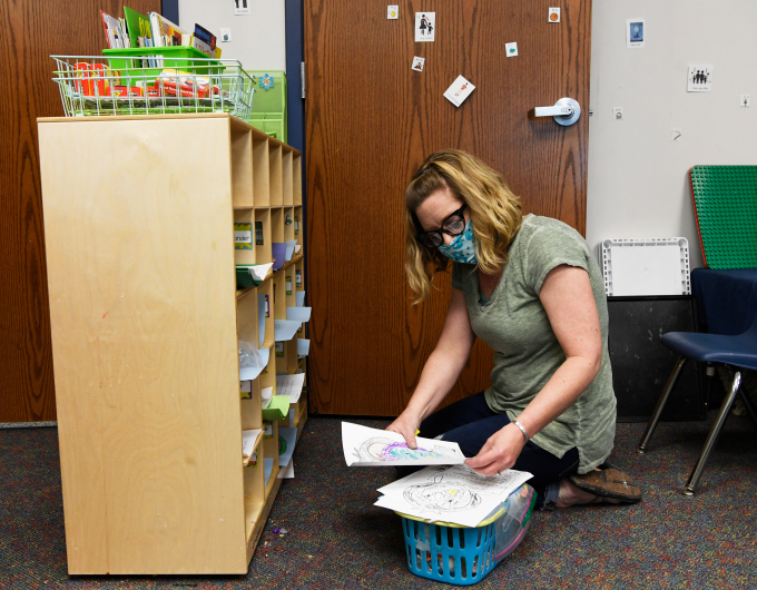 STEM Launch School kindergarten teacher Carrie Brown cleans out her students' cubbies in her classroom May 15, 2020.