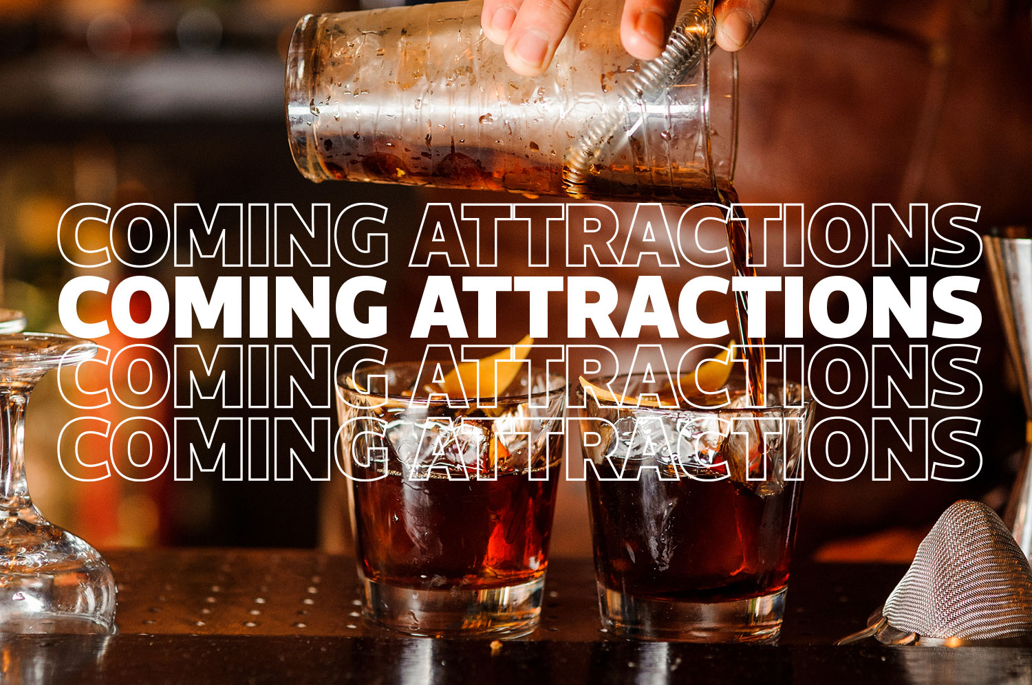 A hand pouring a mixed cocktail into two glasses on a bar behind text that reads Coming Attractions