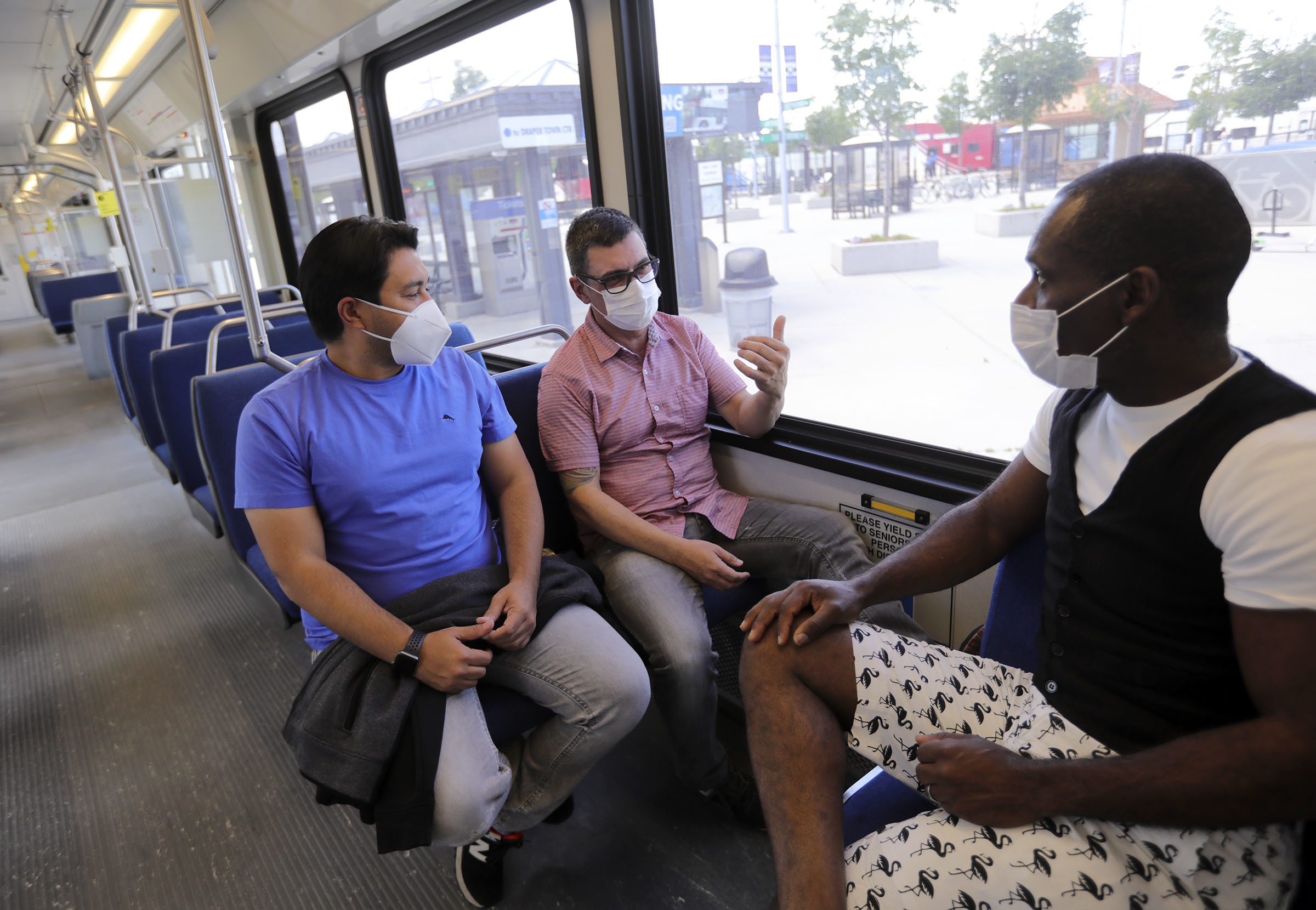 Tiberio Barros,Marcelo Vasconcelos and Gomans Marcus wear masks while waiting for their TRAX train to depart the Salt Lake Central Station in Salt Lake City on Wednesday, July 1, 2020. The Utah Transit Authority now requires face masks be worn in order to ride public transit in compliance with the Salt Lake County health order.