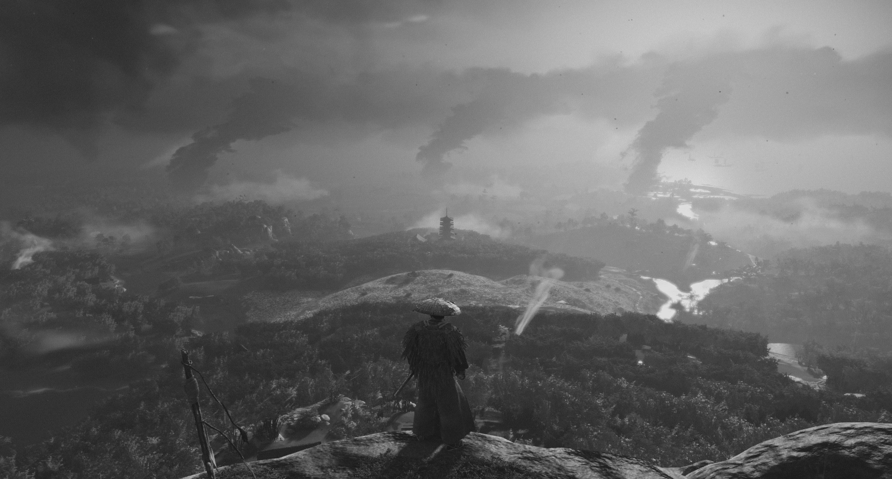 A samurai stands on a hill overlooking a desolate town in Ghost of Tsushima