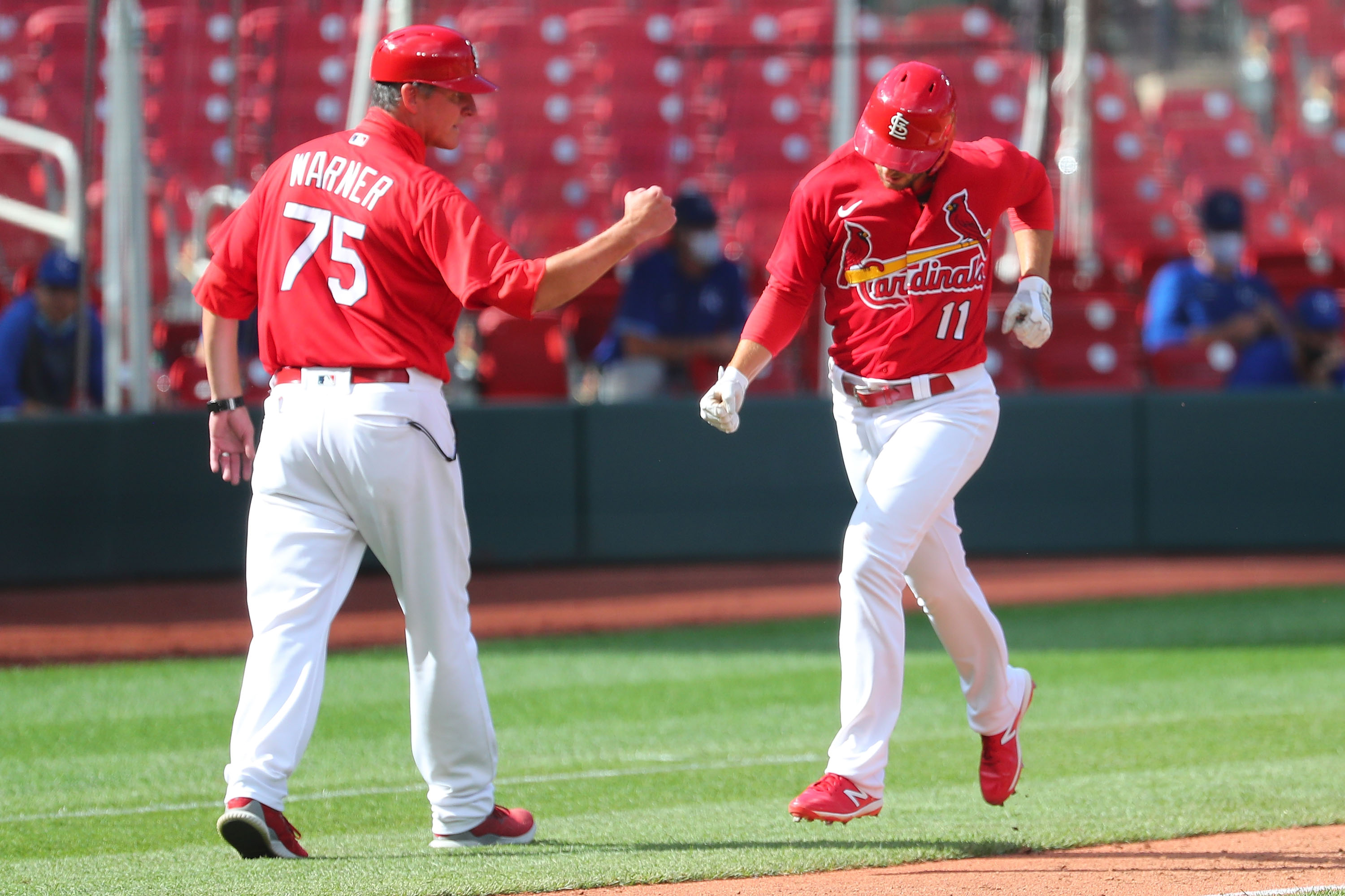 Paul DeJong #11 of the St. Louis Cardinals celebrates with base coach Ron Warner #75 of the St. Louis Cardinals after hitting a two-run home run against the Kansas City Royals at Busch Stadium on July 22, 2020 in St Louis, Missouri.