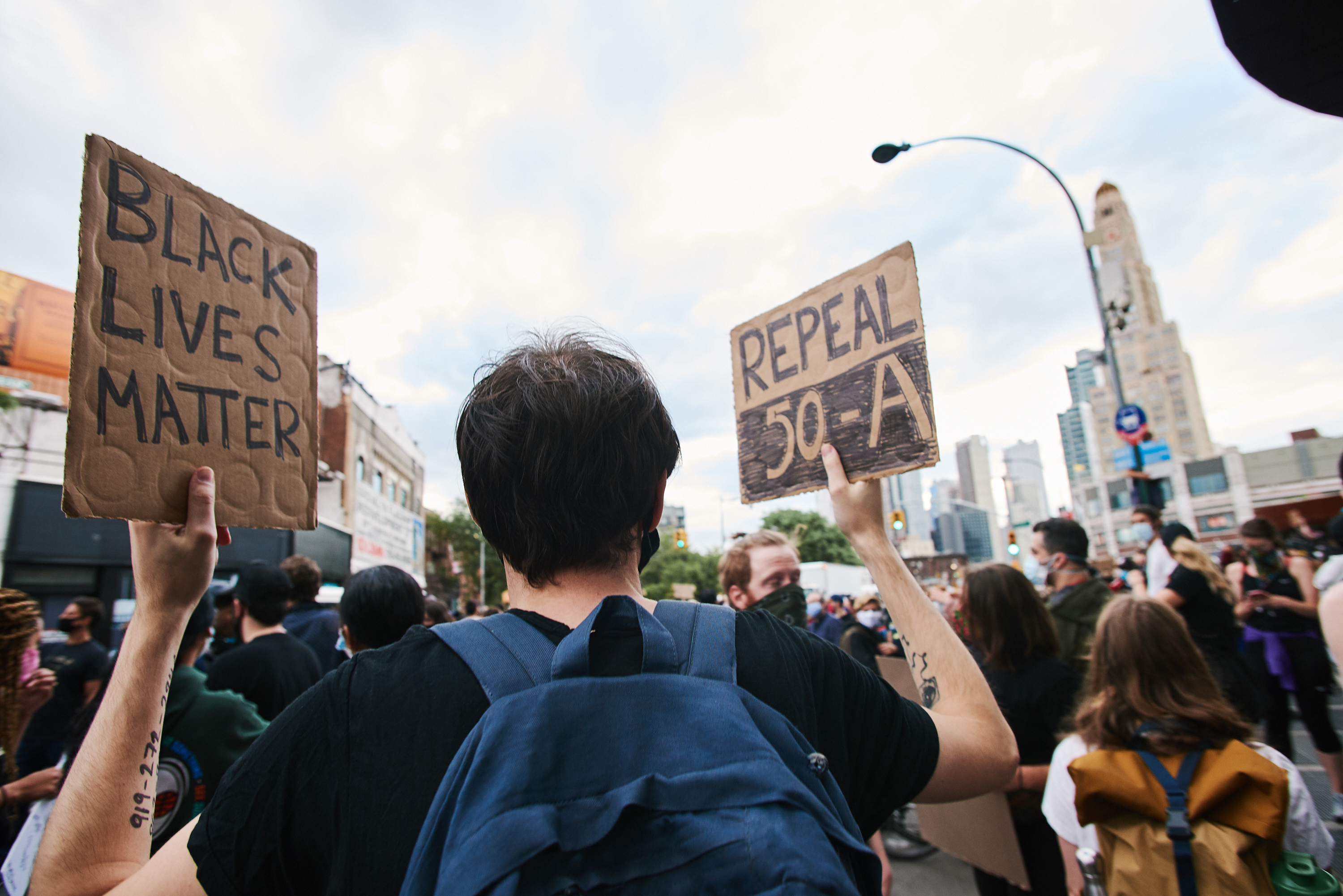 A protester calls for the repeal of a law shielding NYPD officer disciplinary records, June 2, 2020.