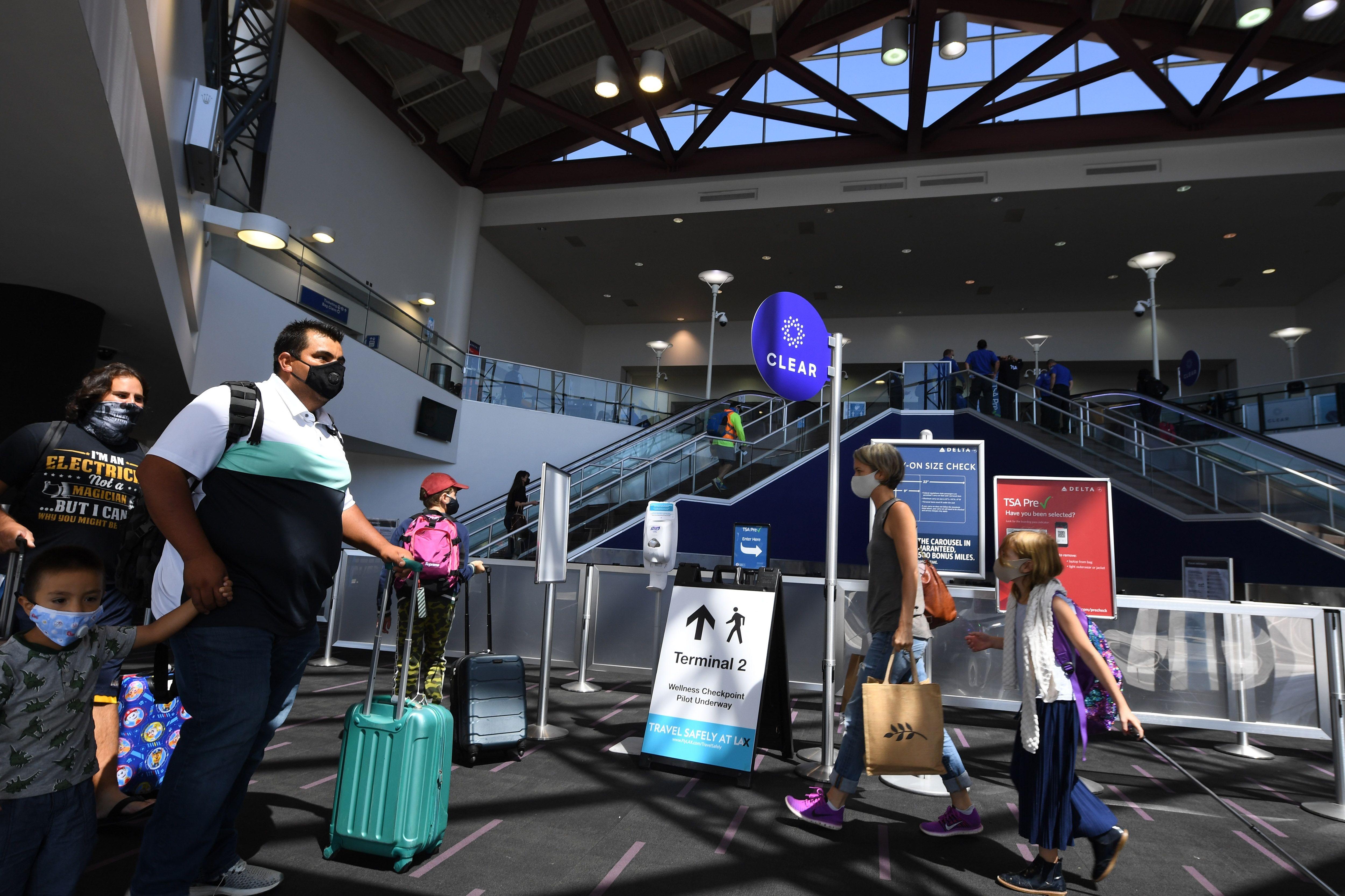 People walking through an airport terminal