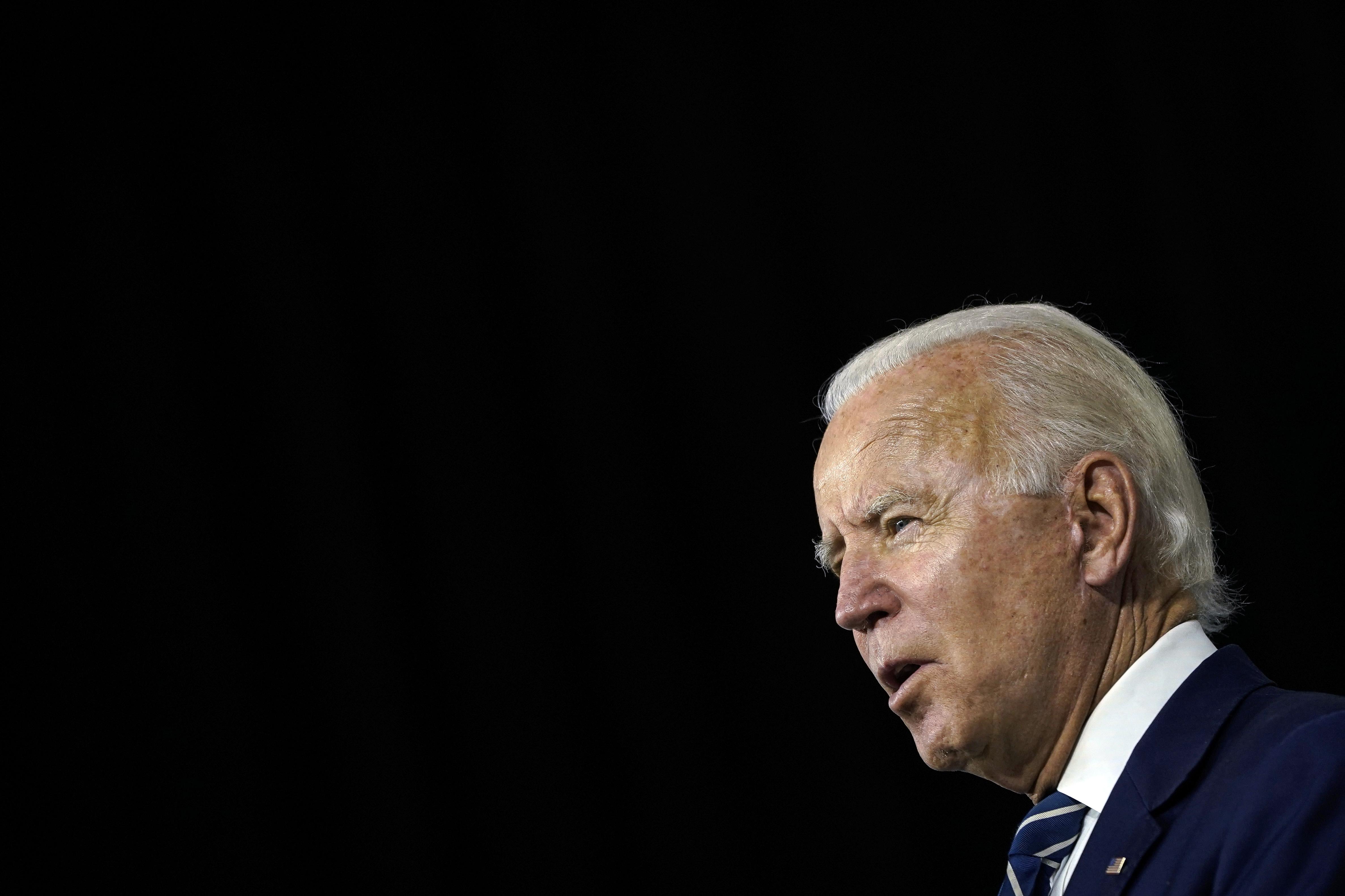 Joe Biden in profile, speaking.
