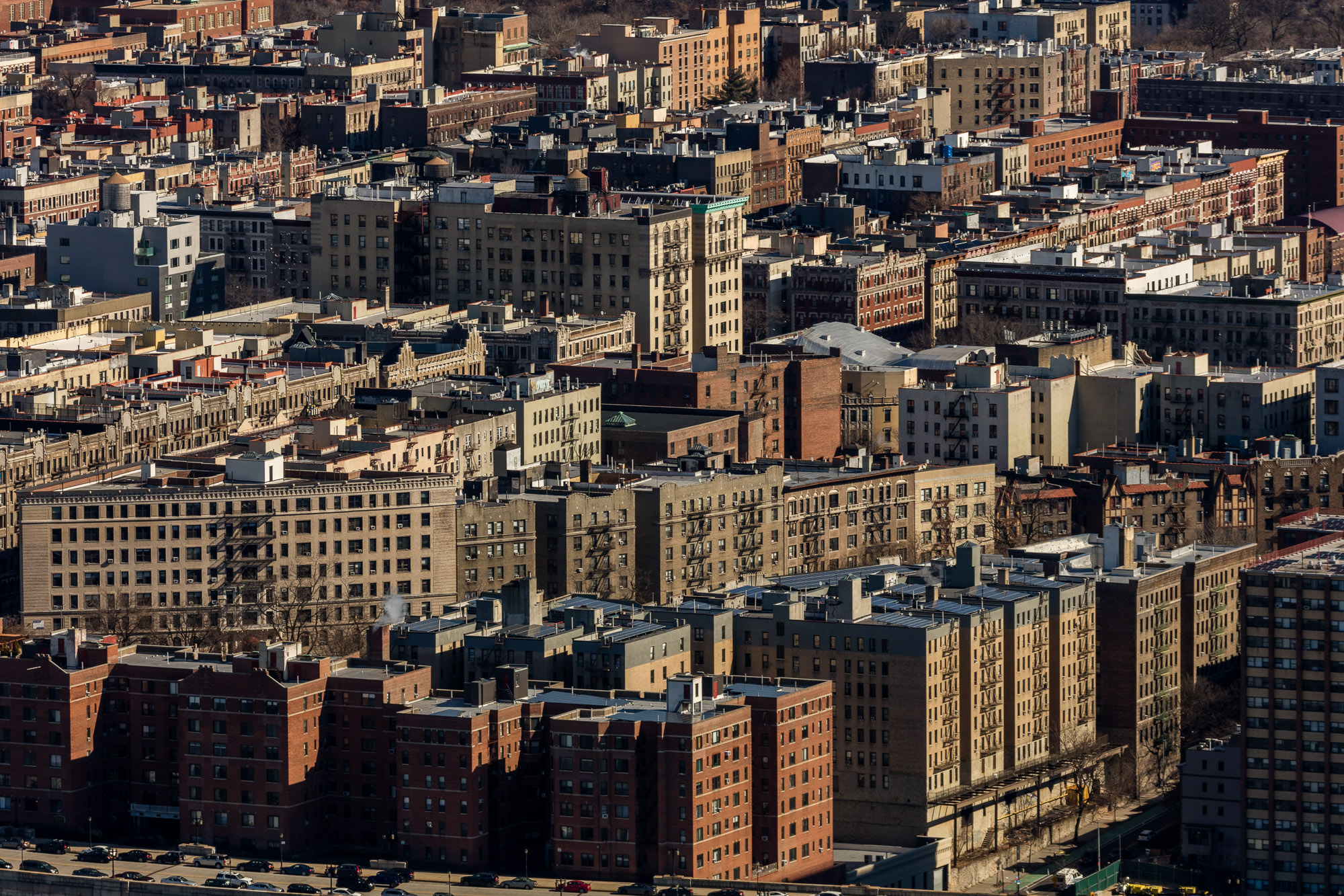 Dozens of high-rise apartment buildings densely packed together in Northern Manhattan.