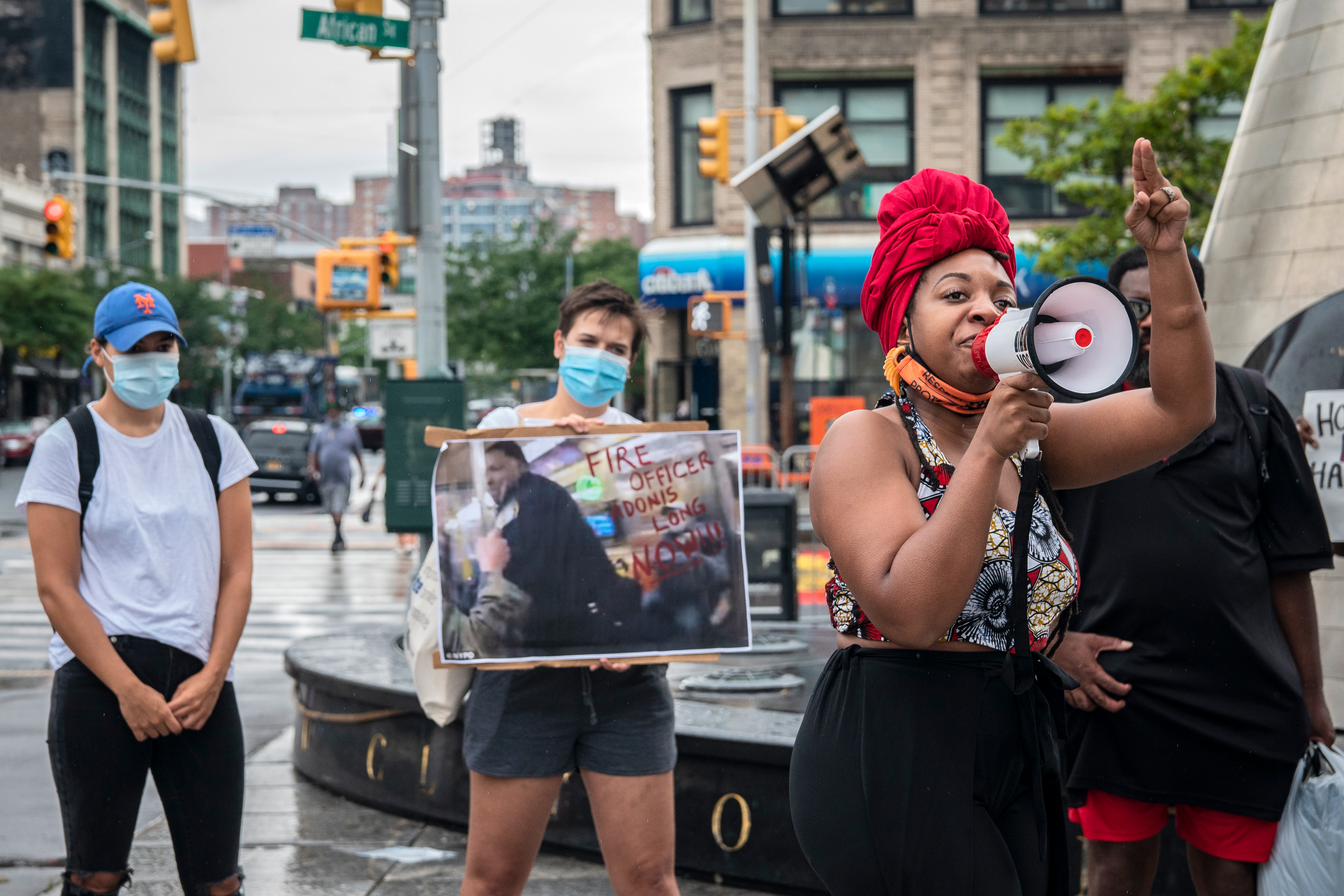 Organizer Celina Trowell, speaks at a rally in Harlem calls for the firing of a cop seen on video punching a homeless man, July 24, 2020.