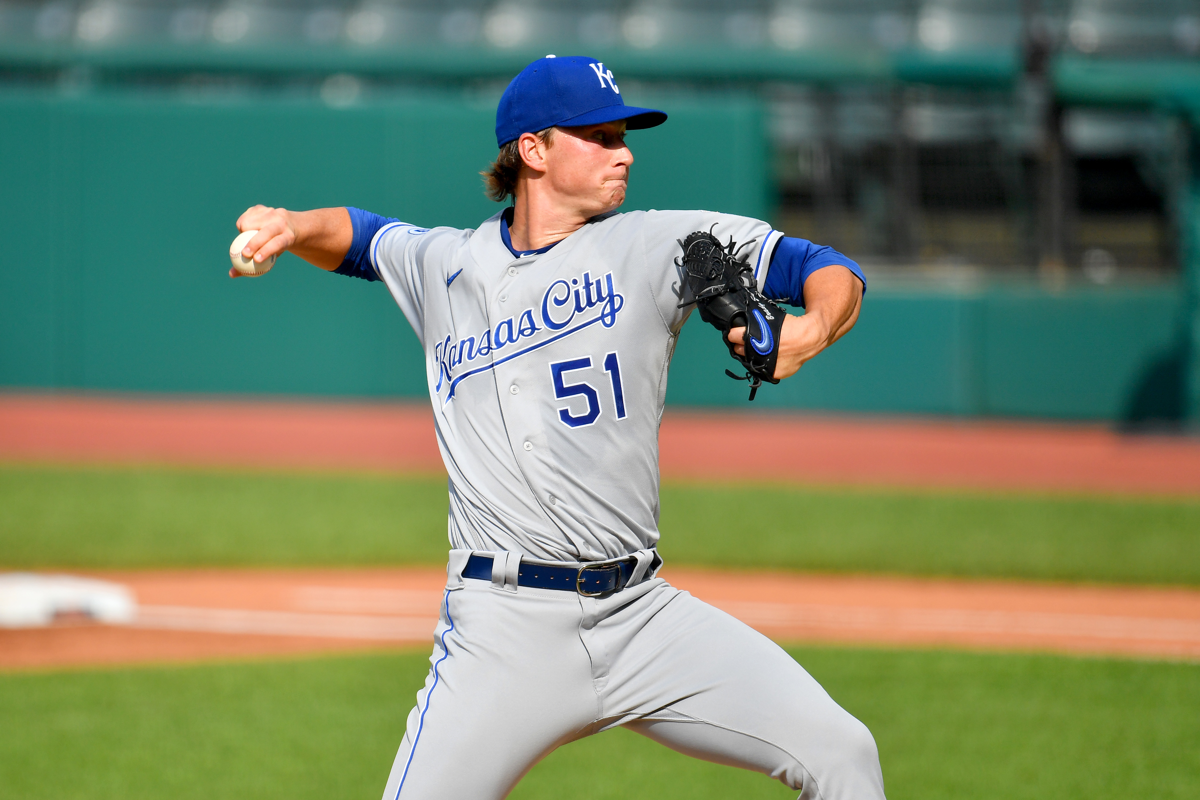 Starting pitcher Brady Singer #51 of the Kansas City Royals pitches during the first inning against the Cleveland Indians at Progressive Field on July 25, 2020 in Cleveland, Ohio. The 2020 season had been postponed since March due to the COVID-19 pandemic.